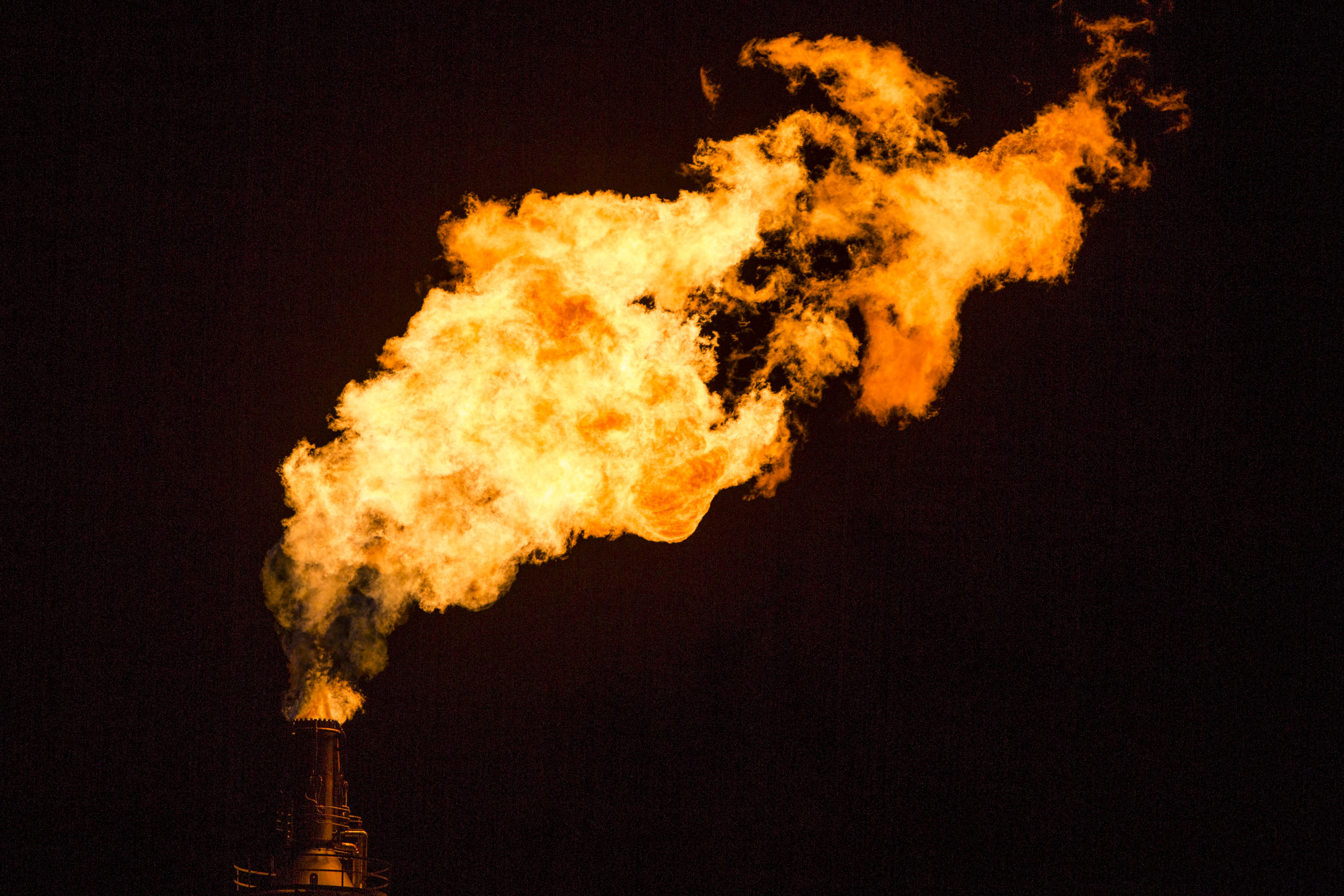 """Energy companies frequently """"flare"""" or burn off vast supplies of methane at drilling sites because it earns less money than oil."""