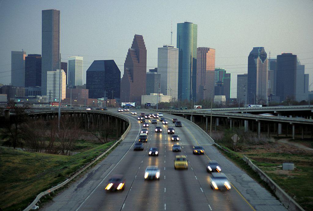 Texas, Houston, Skyline At Dusk And Commuter Traffic