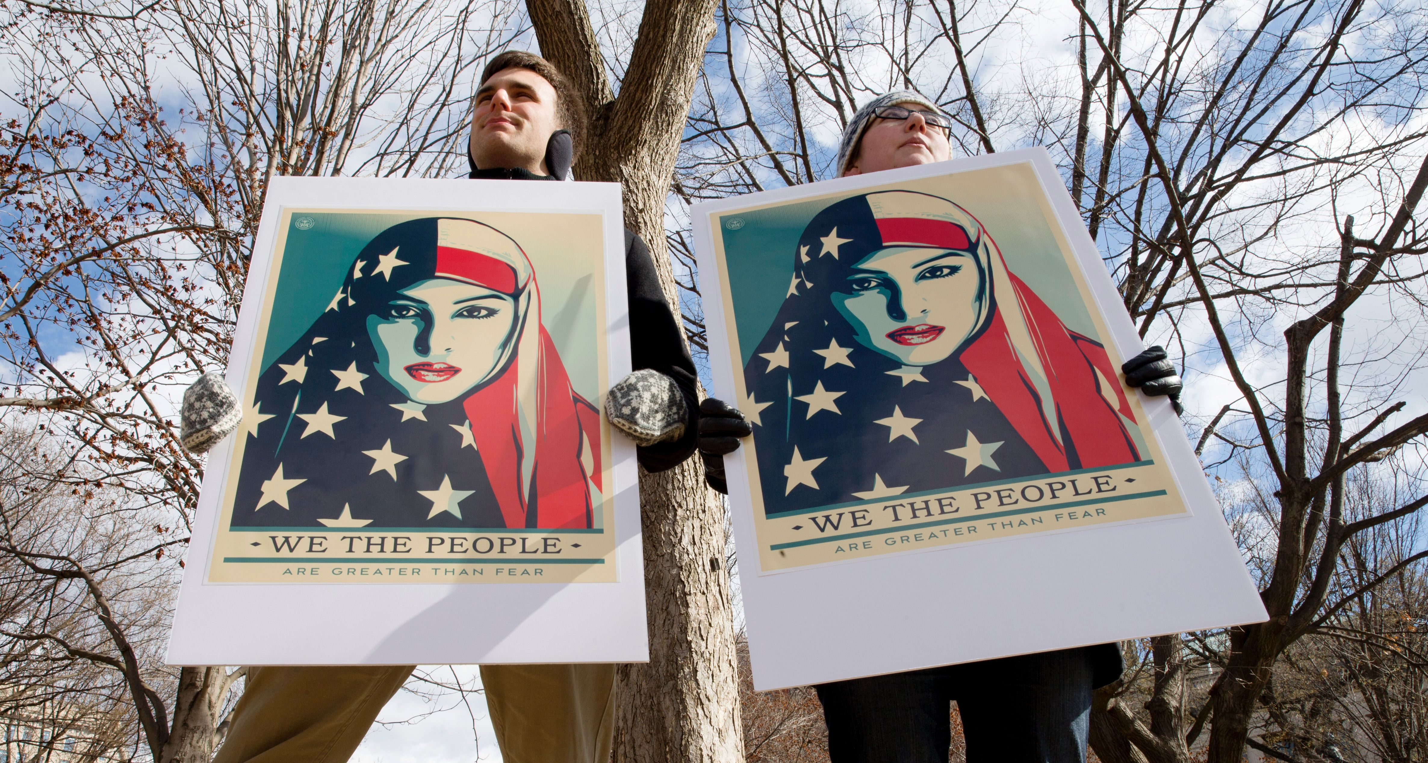 Demonstrators gather near The White House to protest President Donald Trump's travel ban on six Muslim countries on March 11, 2017 in Washington, D.C.