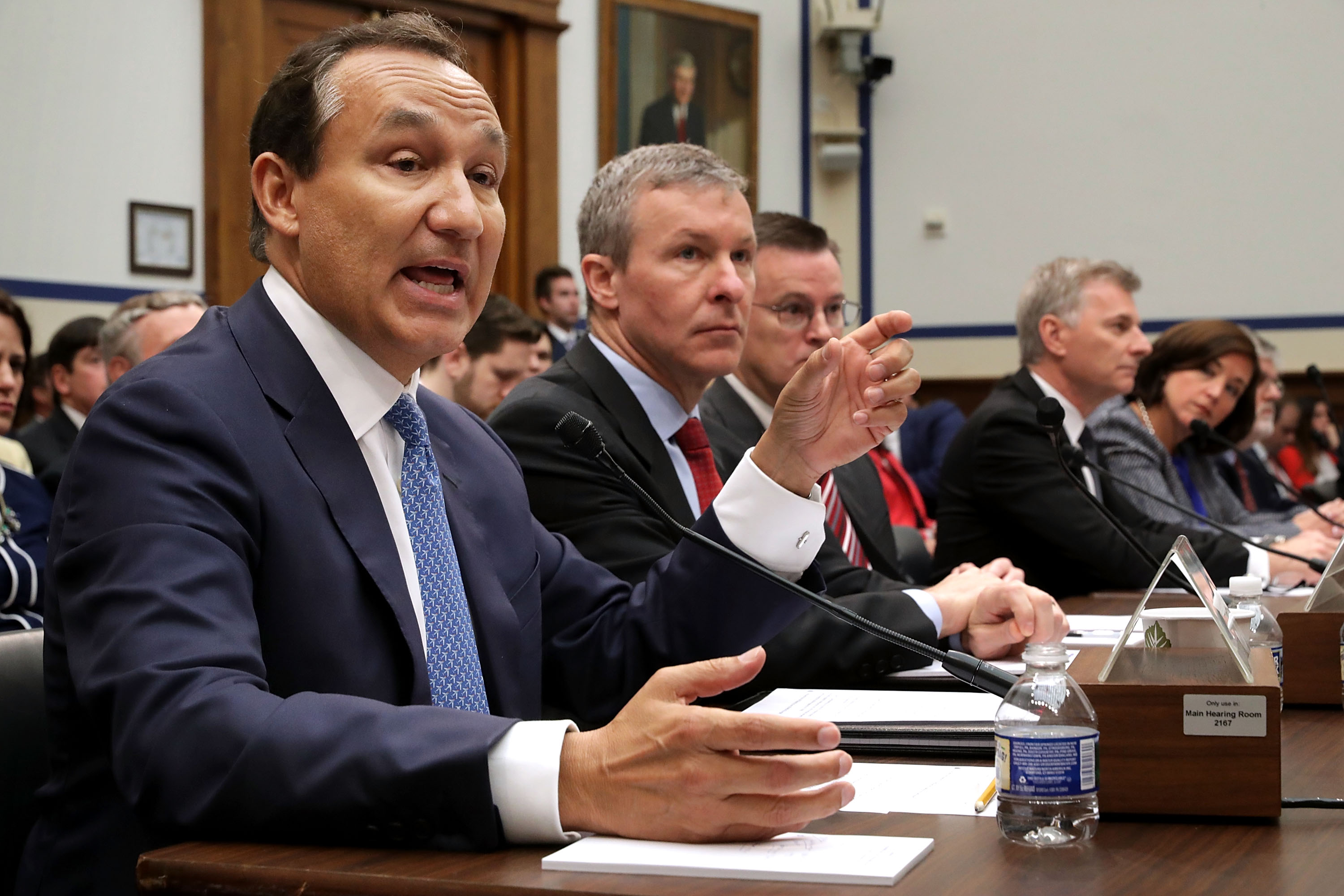 United Airlines CEO Oscar Munoz (left) testifies before the House Transportation and Infrastructure Committee about oversight of U.S. airline customer service.