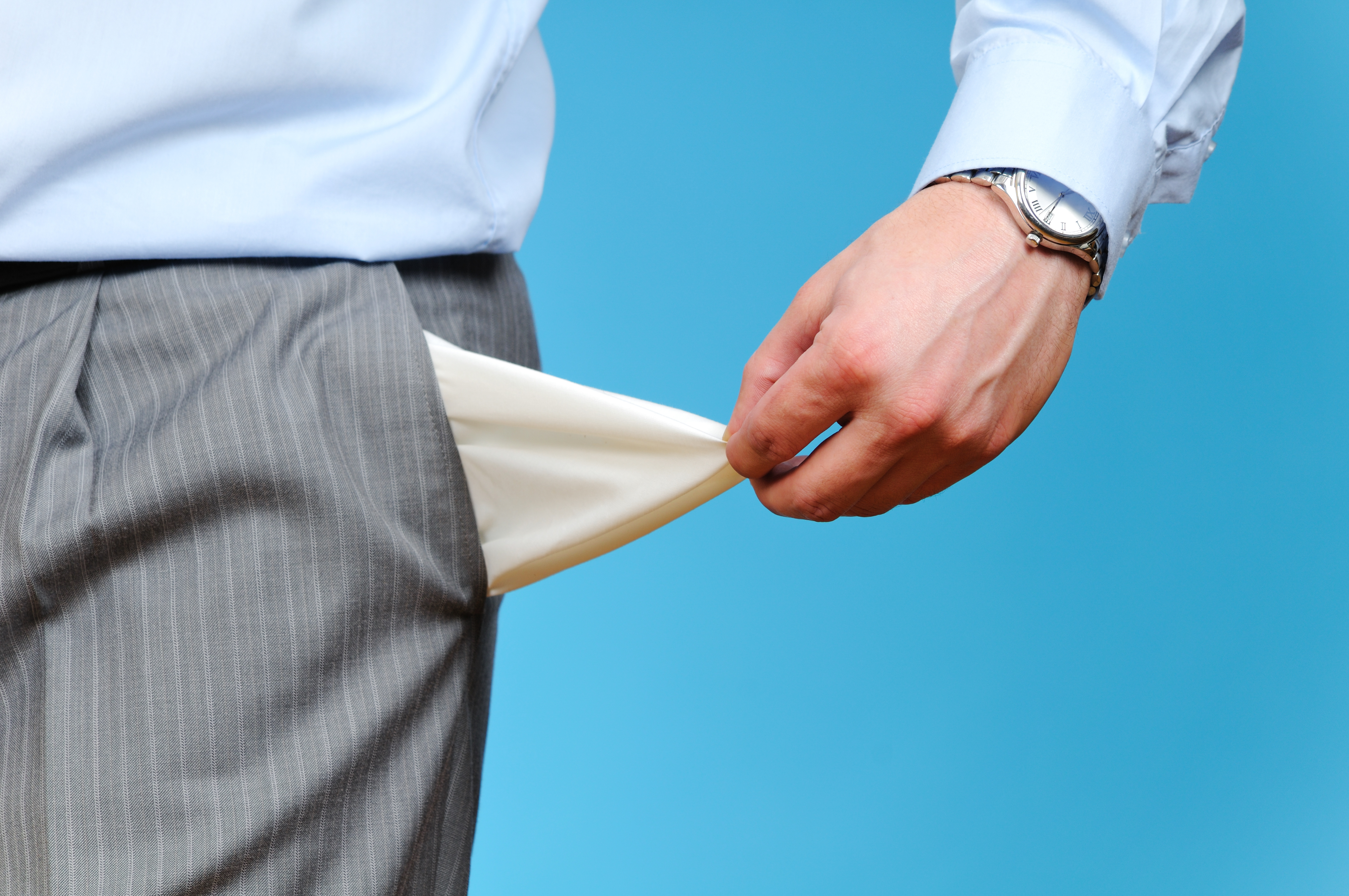 Man Pulling out Empty Pocket
