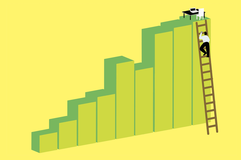 Businessman climbing ladder to reach office desk on top of bar chart