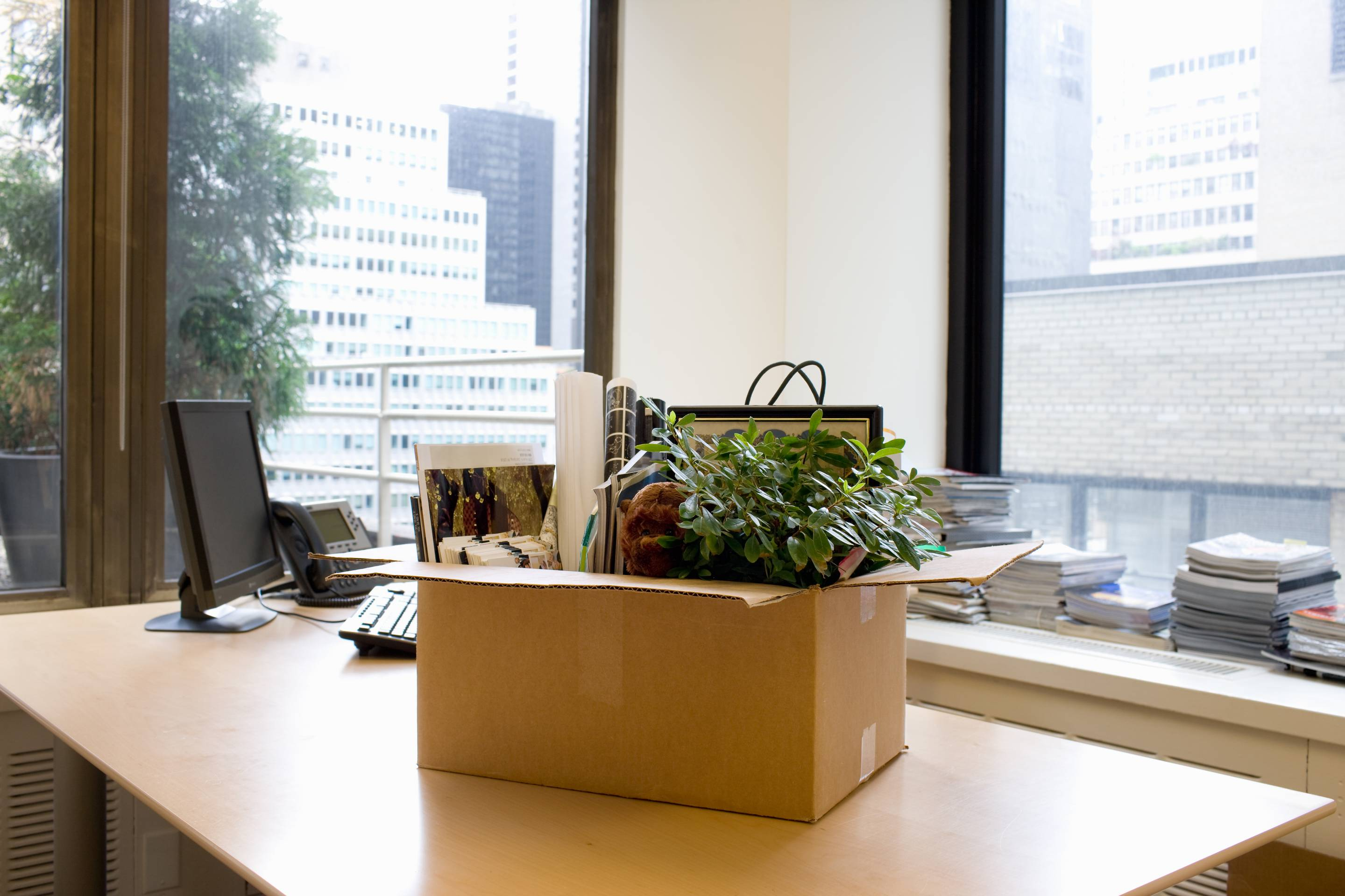 Box of personal items on office desk
