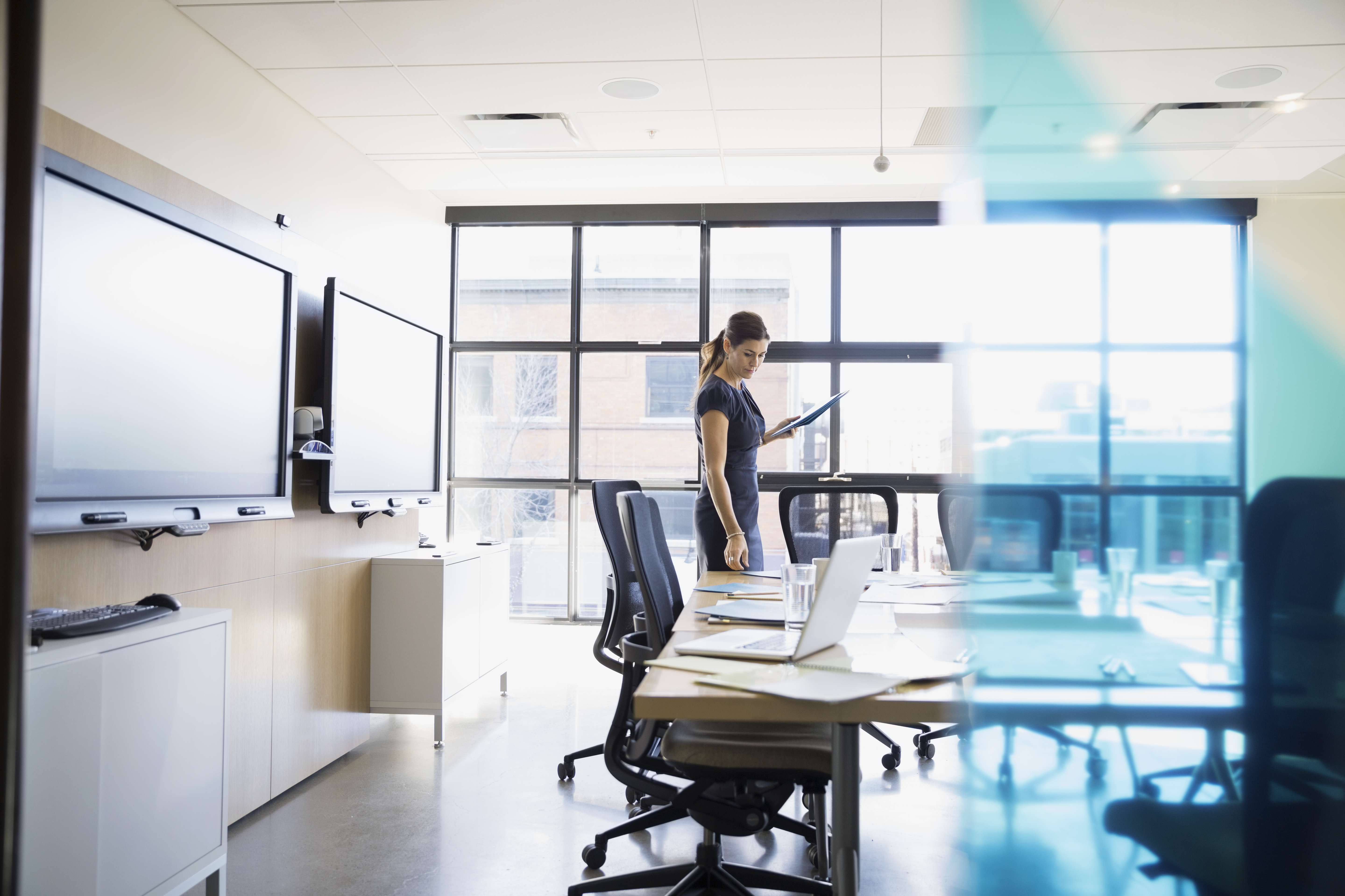 Businesswoman preparing for meeting in conference room