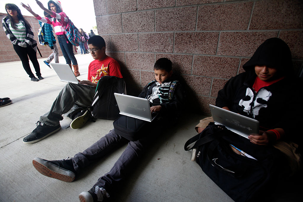 Pinacate Middle School students Jacob Quinino, 13, Brian Guereque, 12 and Joshua Ortega, 12, l to r