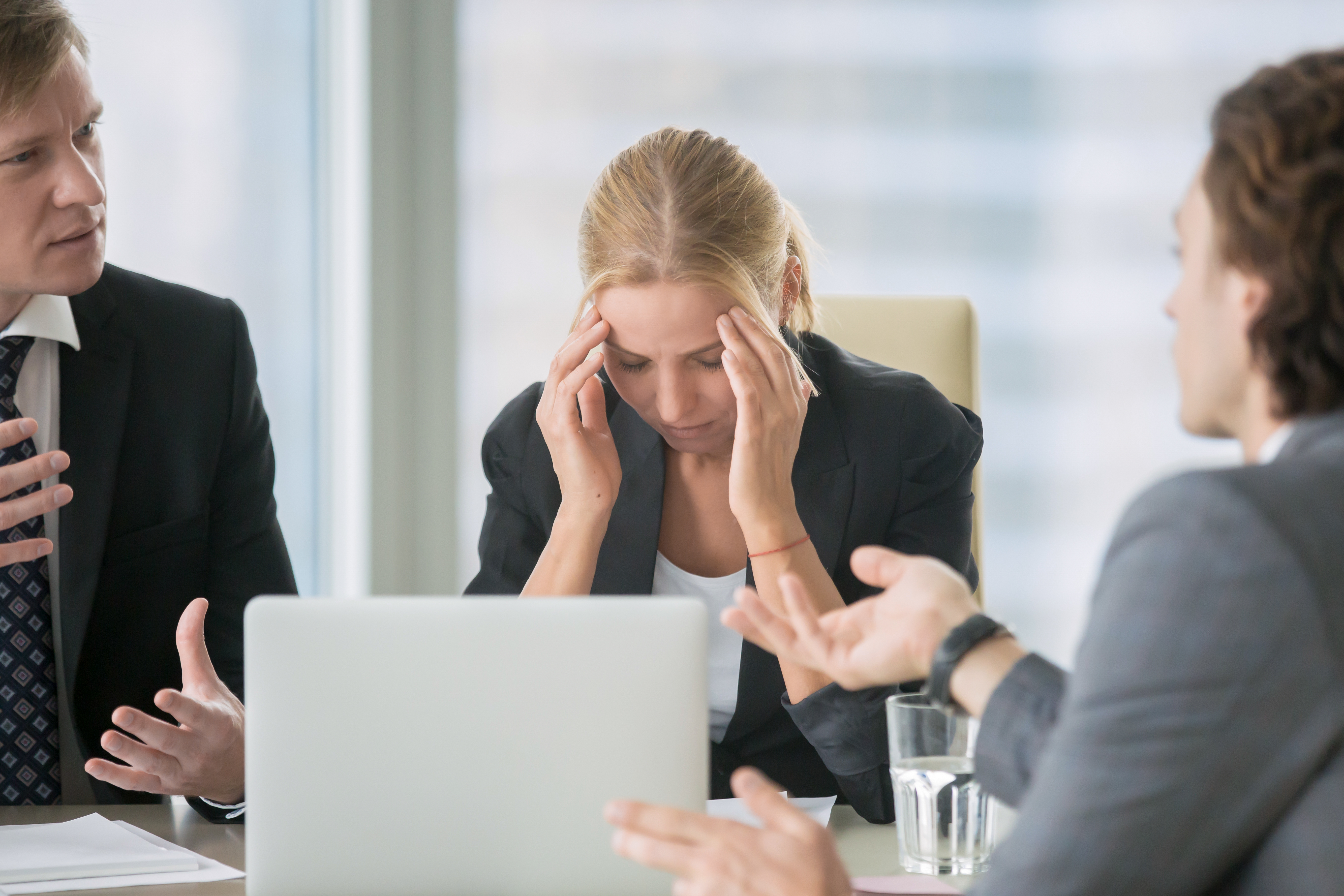 Woman stressed in meeting