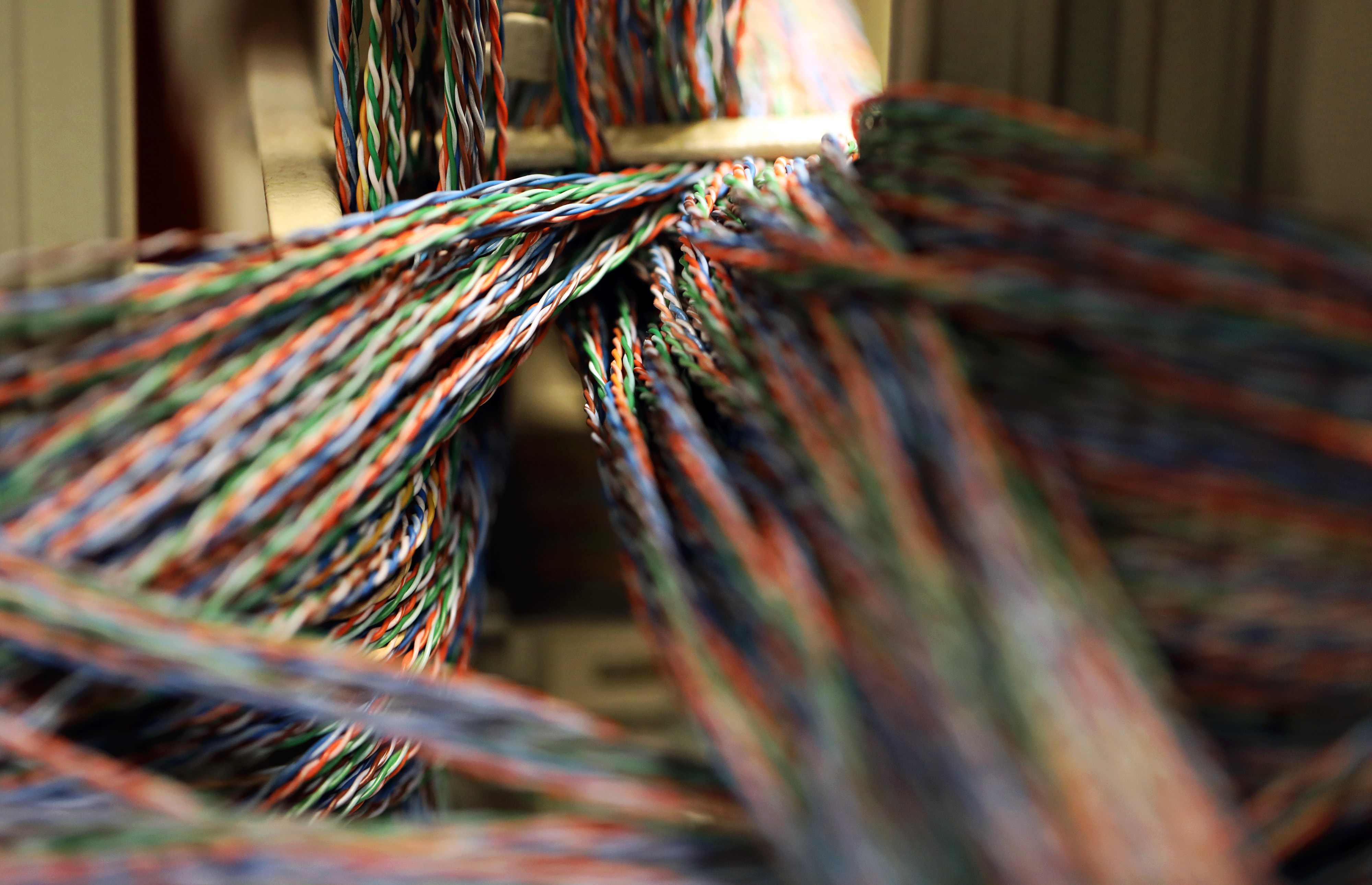 Twisted copper wiring sits in an electrical unit inside a communications room at an office in London, U.K., on Monday, May 15, 2017.