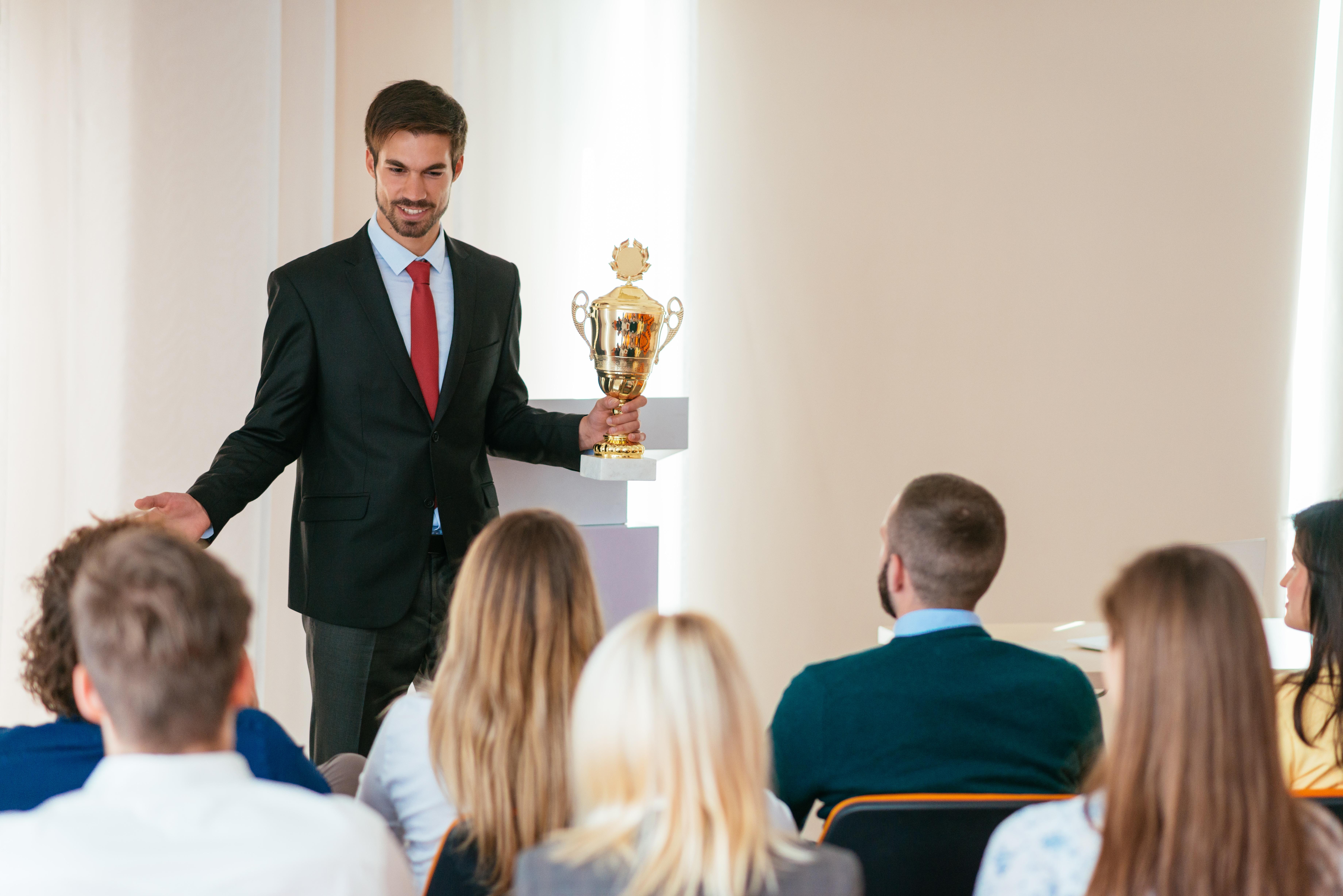 Man receiving trophy