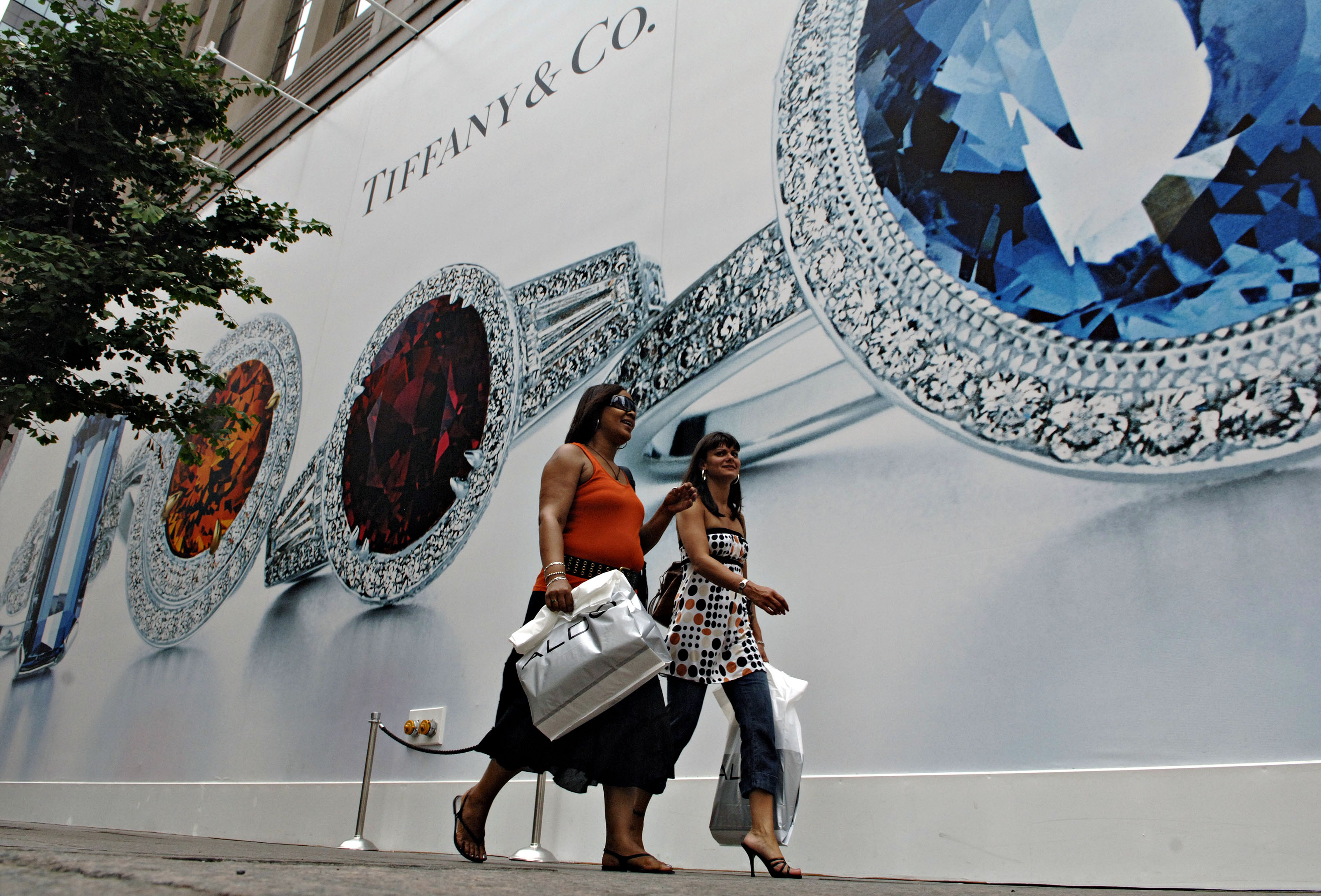 Pedestrians pass Tiffany & Co.'s flagship store in New York,