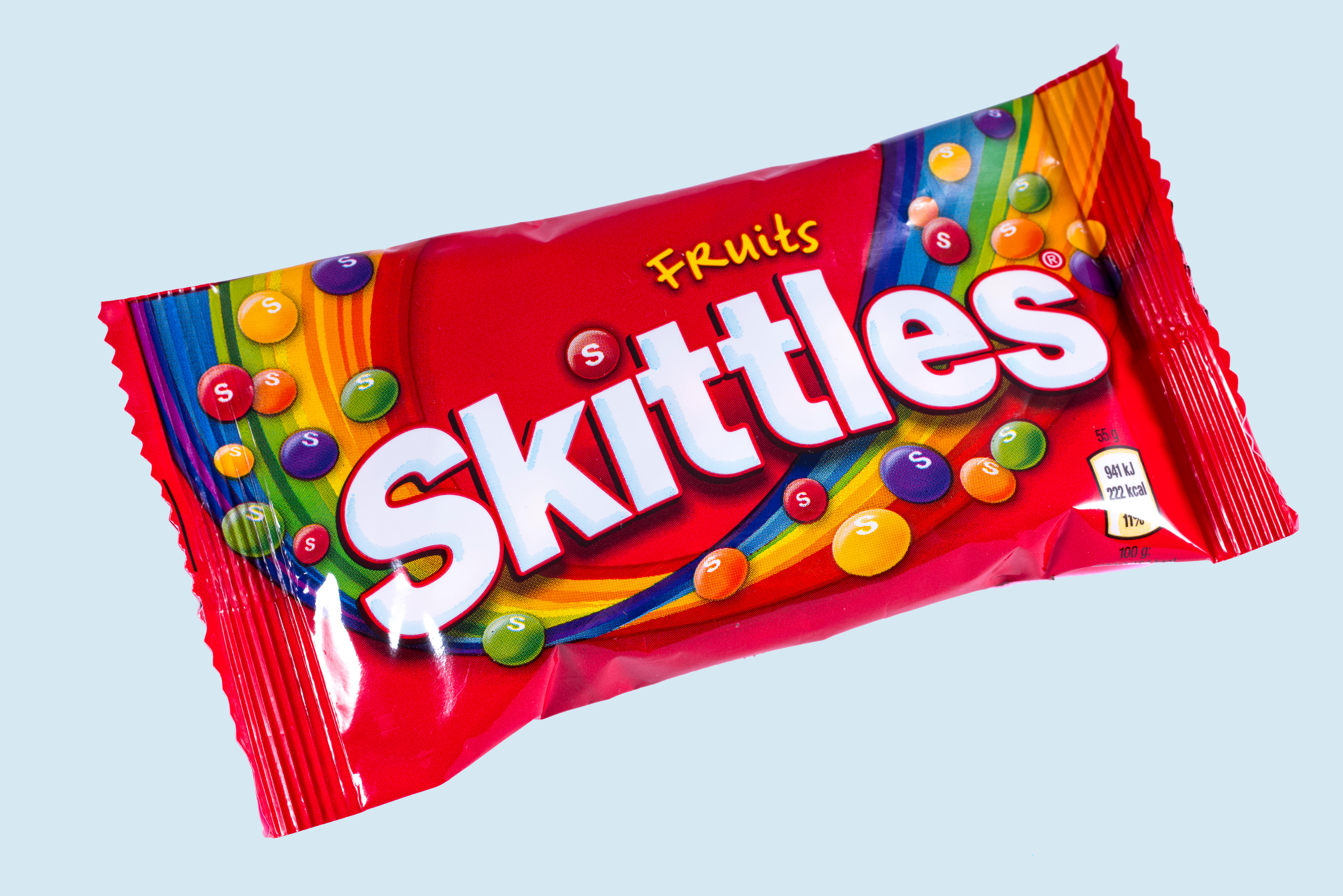 LONDON, UK - OCTOBER 13TH 2016: An unopened pack of Fruit Skittles over a plain white background, on 13th October 2016.