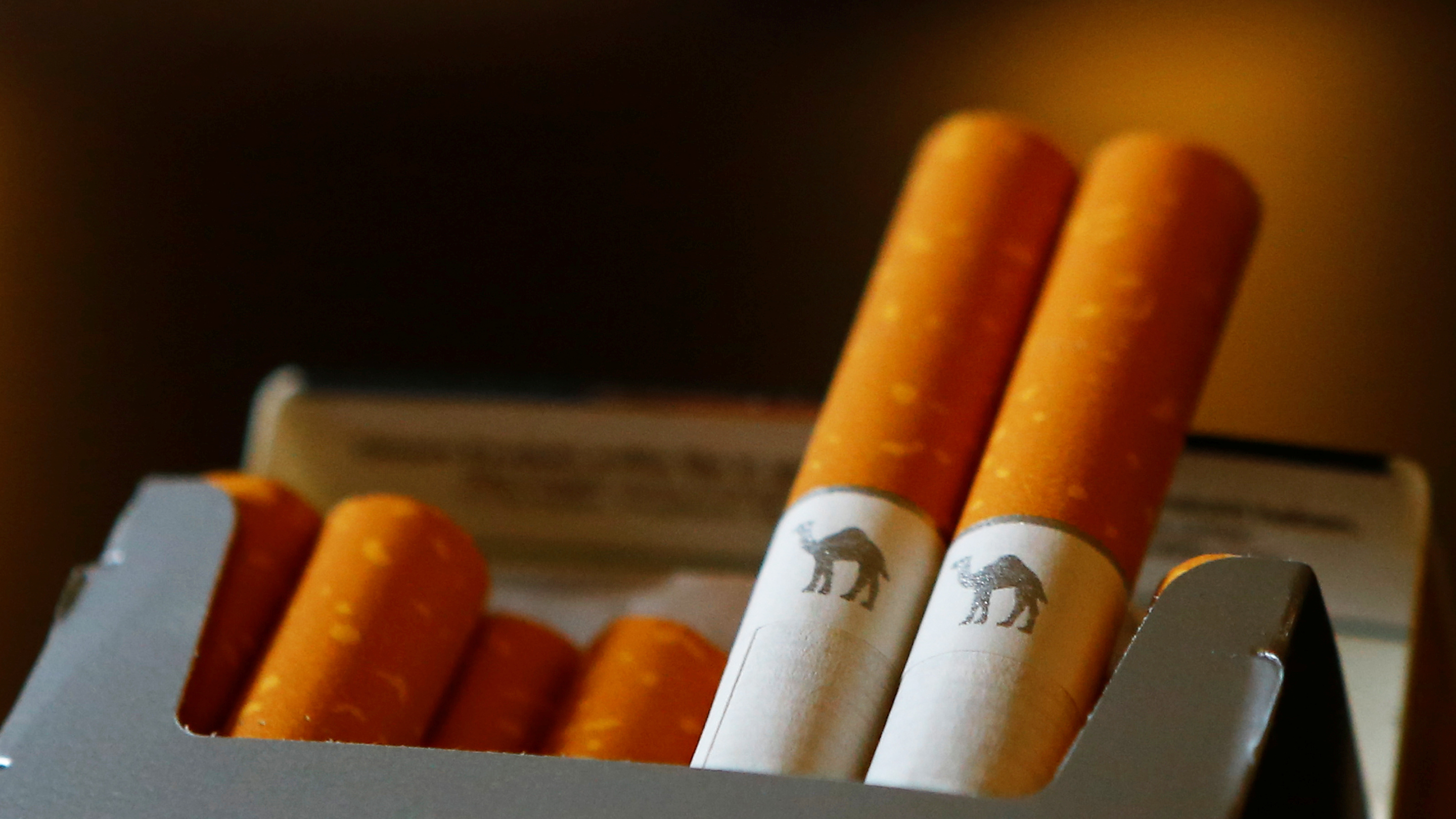 An illustration picture shows a pack of Camel cigarettes in a coffee house in Vienna