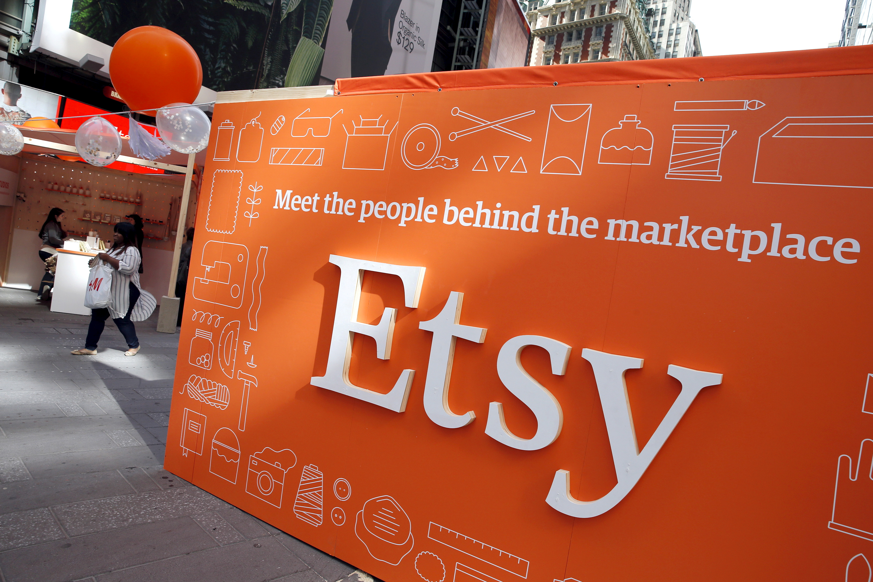 A sign advertising the online seller Etsy Inc. is seen outside the Nasdaq market site in Times Square following Etsy's IPO in New York