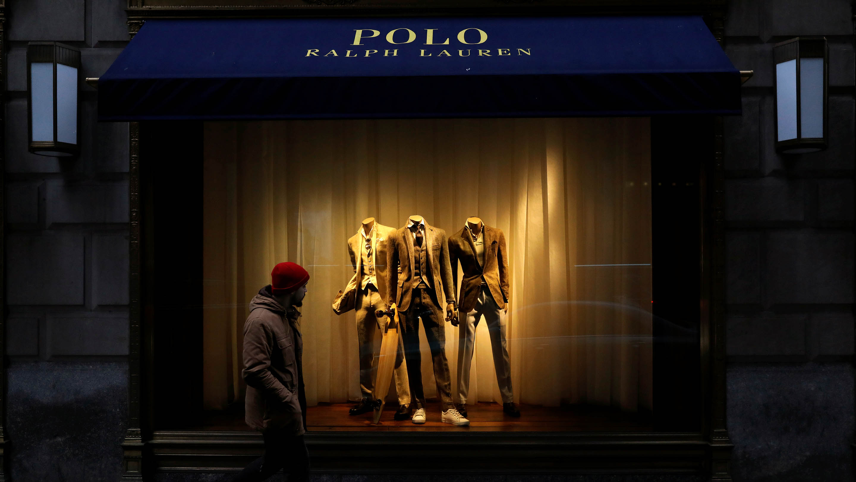 A man walks past Ralph Lauren Corp.'s  flagship Polo store on Fifth Avenue in New York