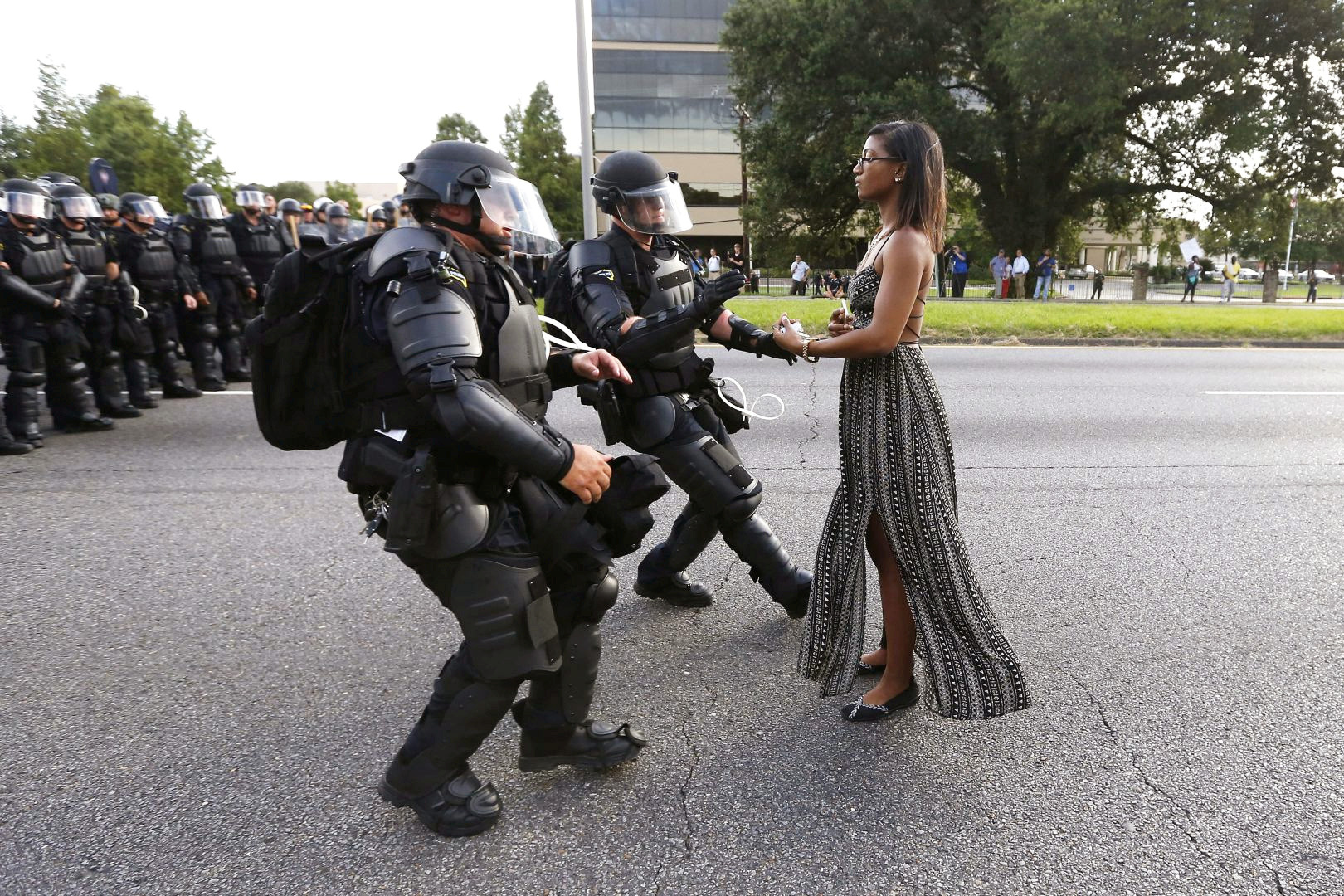FILE PHOTO -- Lone activist Ieshia Evans stands her ground while offering her hands for arrest as she is charged by riot police during a protest against police brutality outside the Baton Rouge Police Department in Louisiana