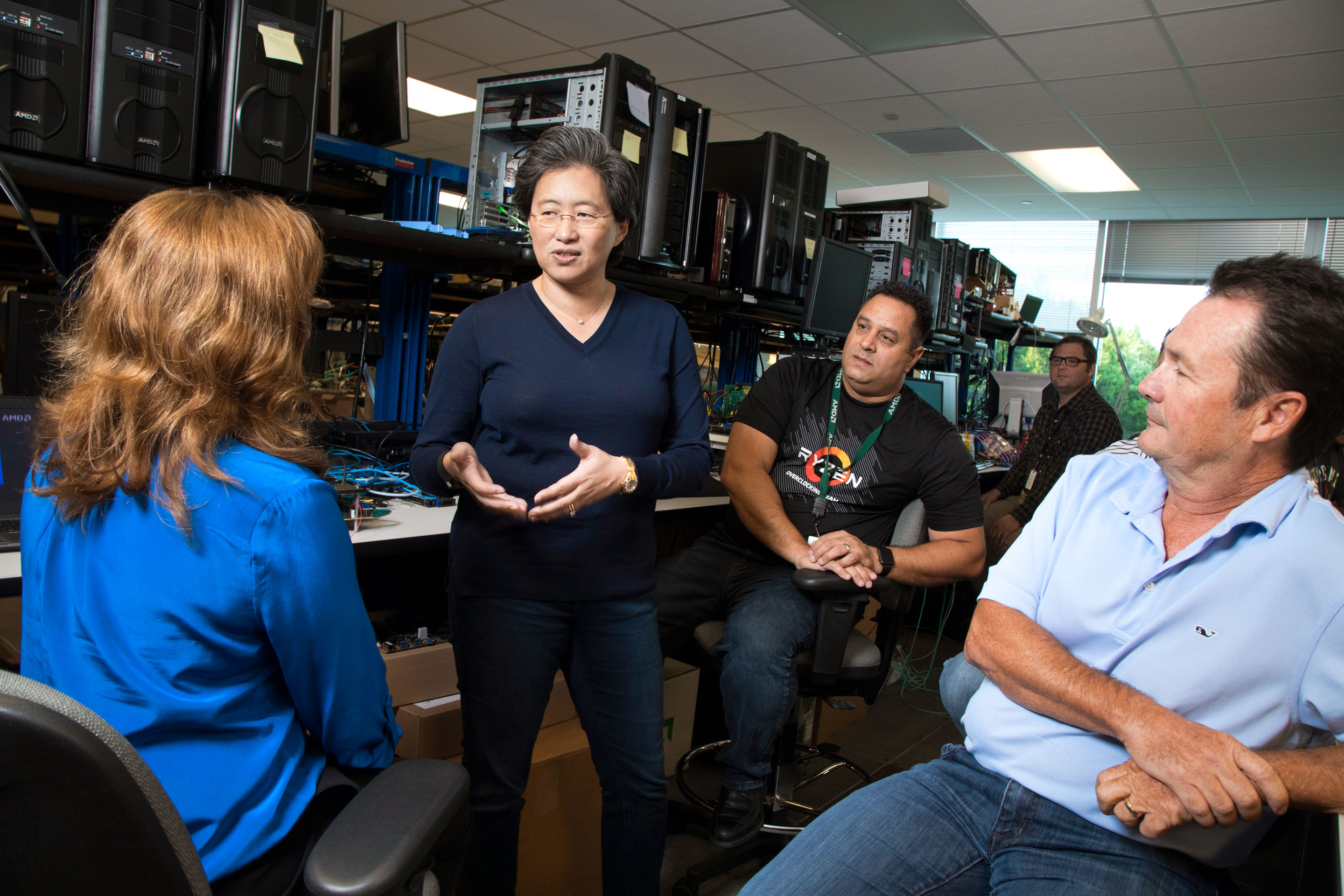 AMD CEO Lisa Su in the lab with Louis Castro (in Ryzen T-shirt), Lee Rusk (in polo), and other engineers on AMD's Zeppelin chip project.