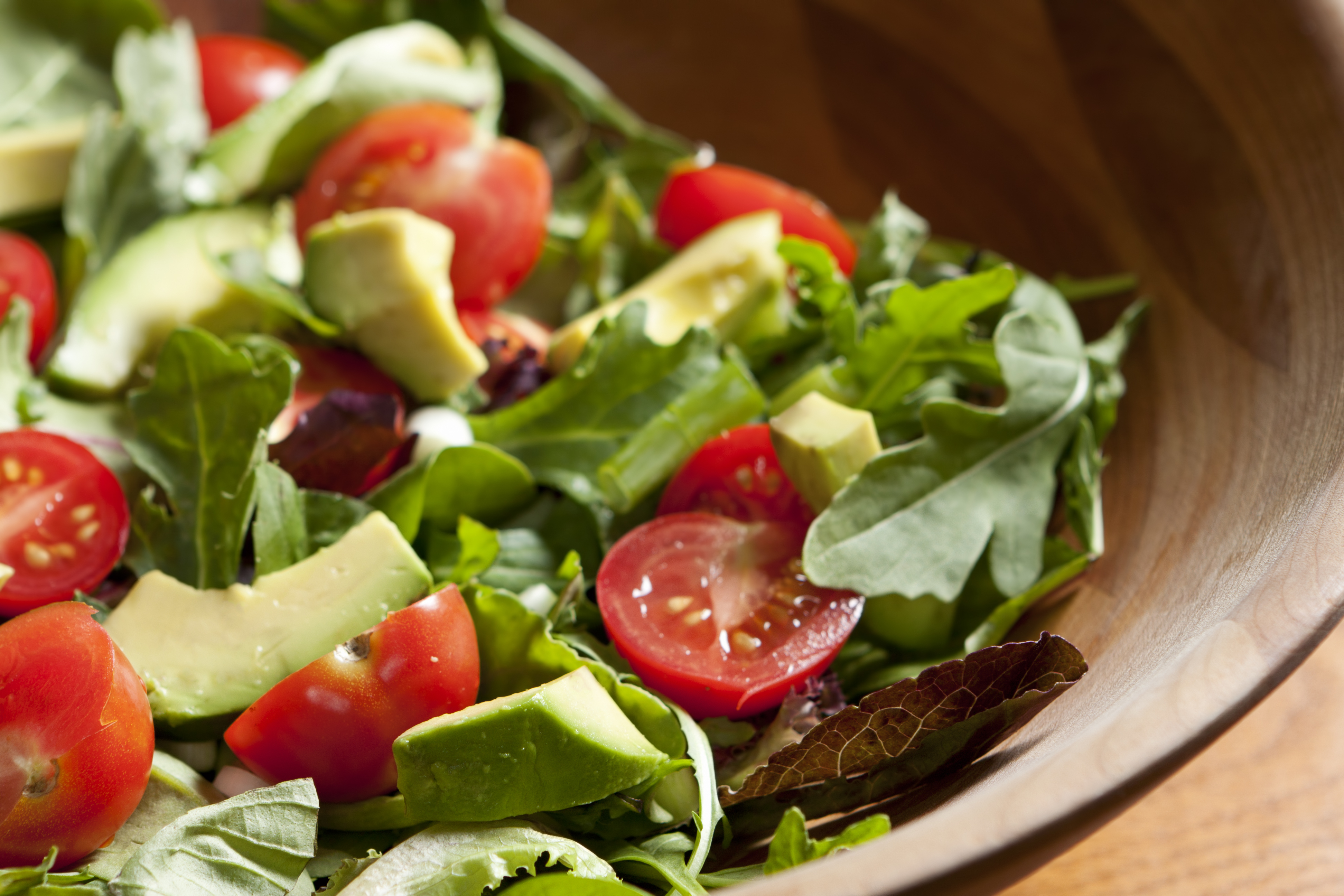 Fresh salad with cherry tomatoes, avocado and mixed greens