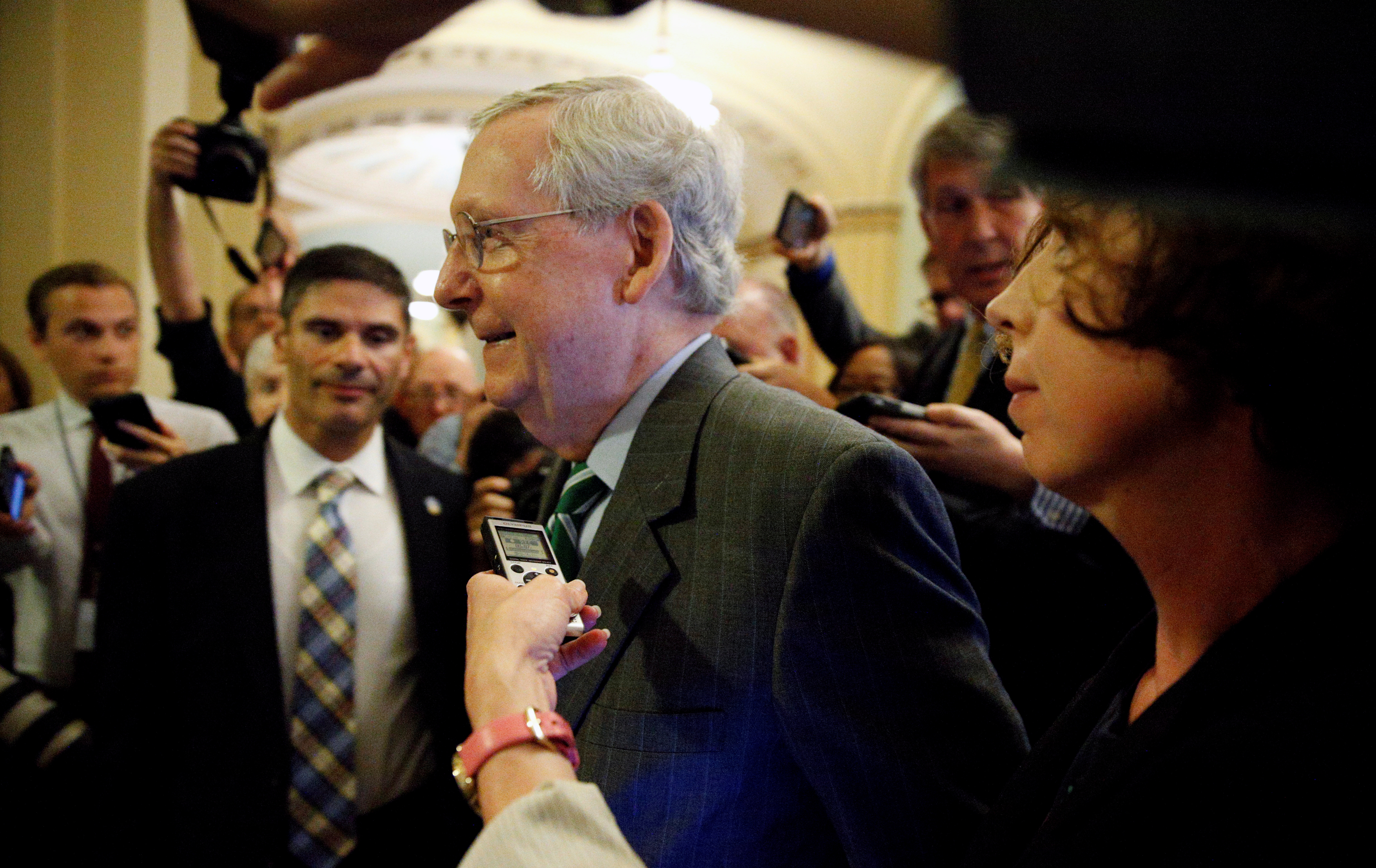 Mitch McConnell walks to the Senate floor in the Capitol in Washington