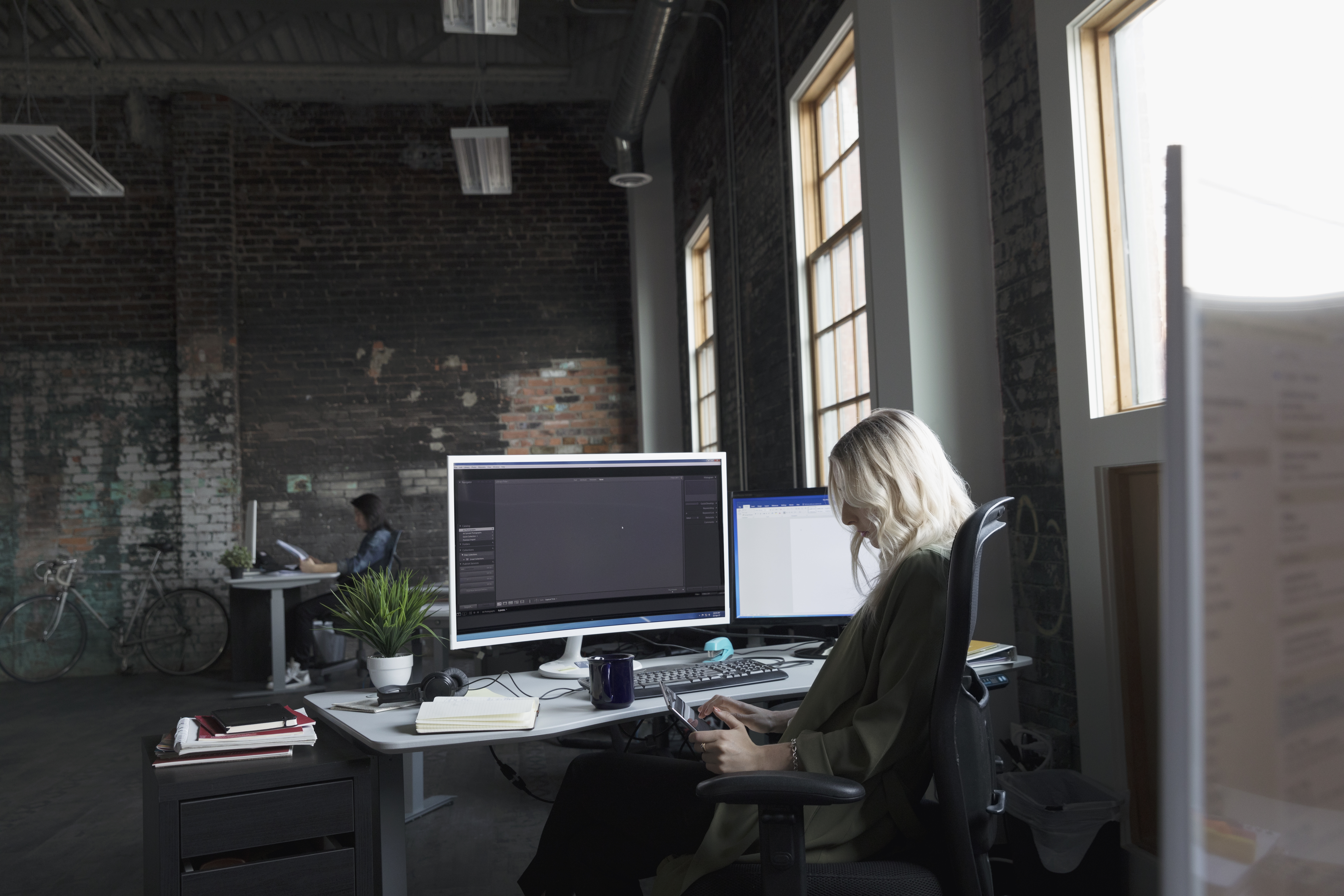Businesswoman working at computer in office