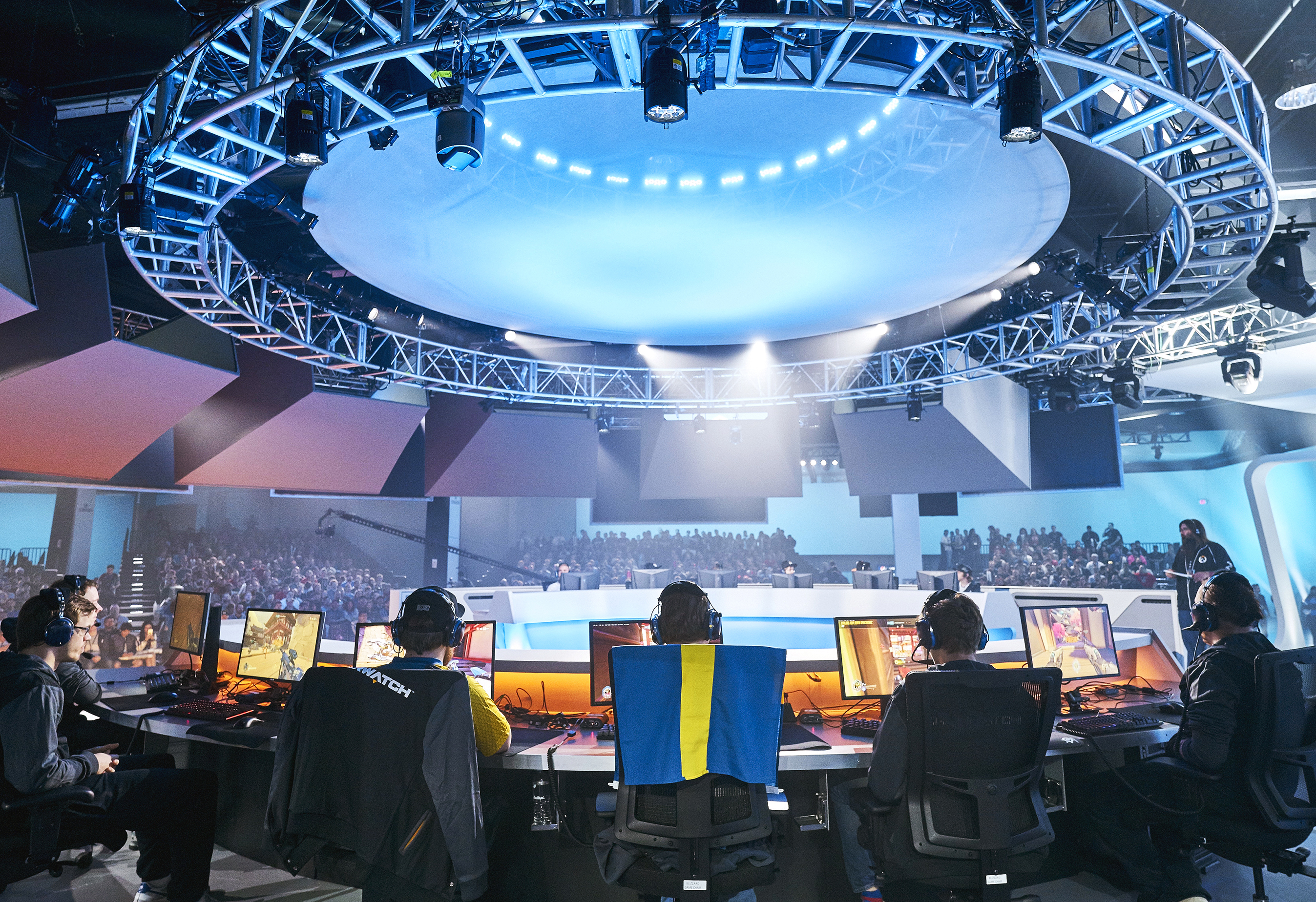 """""""Overwatch"""" competitors inside the The Overwatch Arena at BlizzCon 2016. BlizzCon 2016 was held at the Anaheim Convention Center in California."""