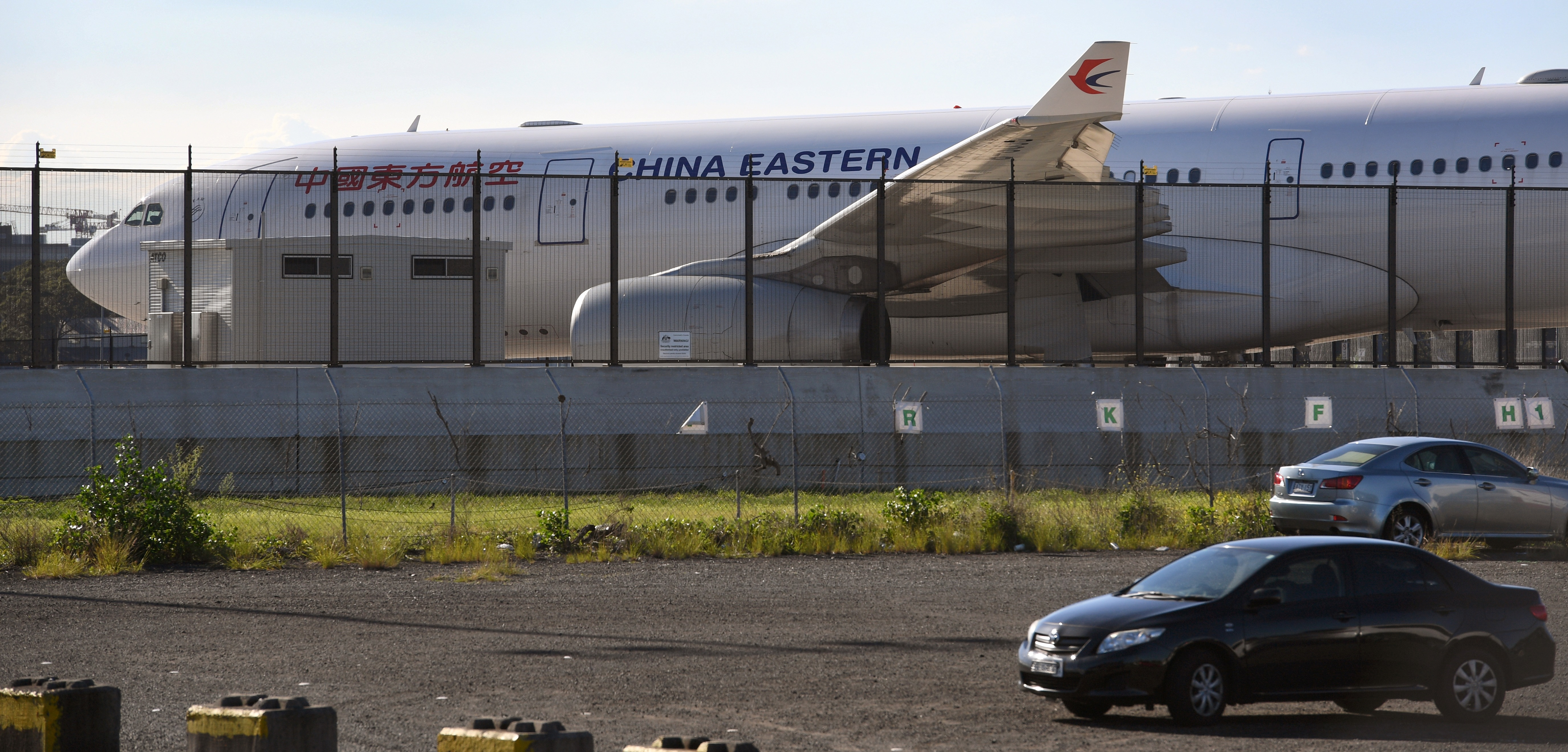 A China Eastern Airbus A330 passenger aircraft, which suffered a serious fault to its starboard engine following take-off, sits on the tarmac at Sydney Airport on June 12, 2017.