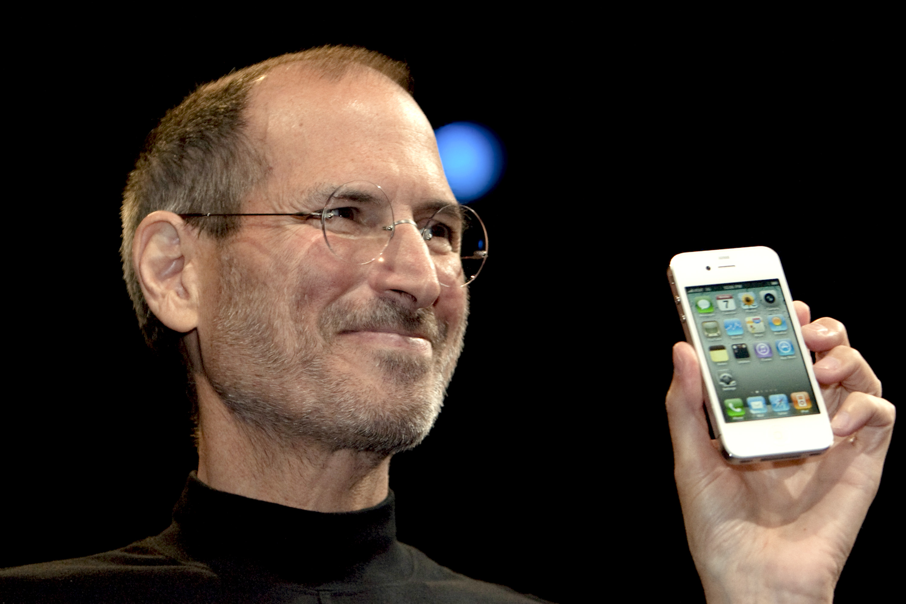Steve Jobs, chief executive officer of Apple, unveils the iPhone 4 during his keynote address at the Apple Worldwide Developers Conference (WWDC) in San Francisco, California, U.S., on Monday, June 7, 2010.