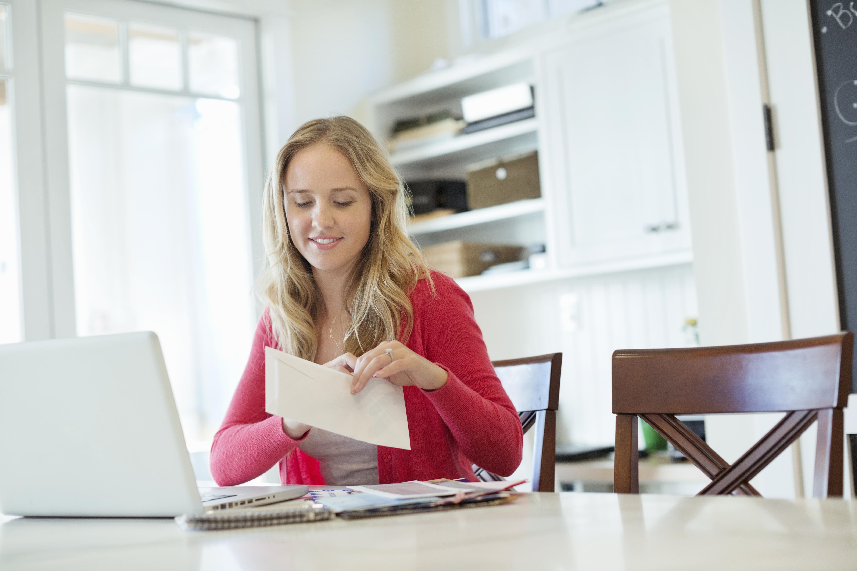 Woman opening envelope