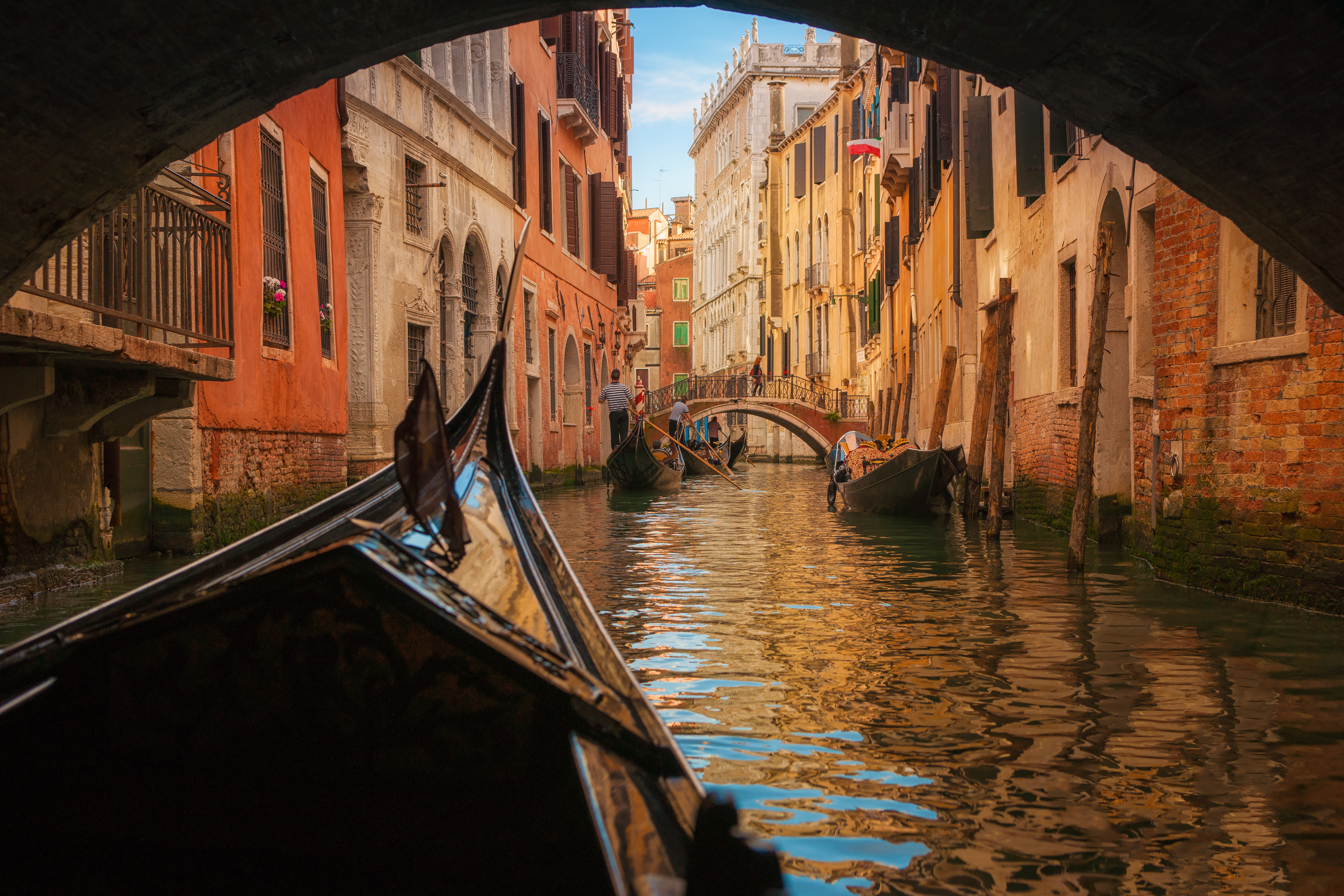 Italy, Veneto, Venice, Gondola under bridge