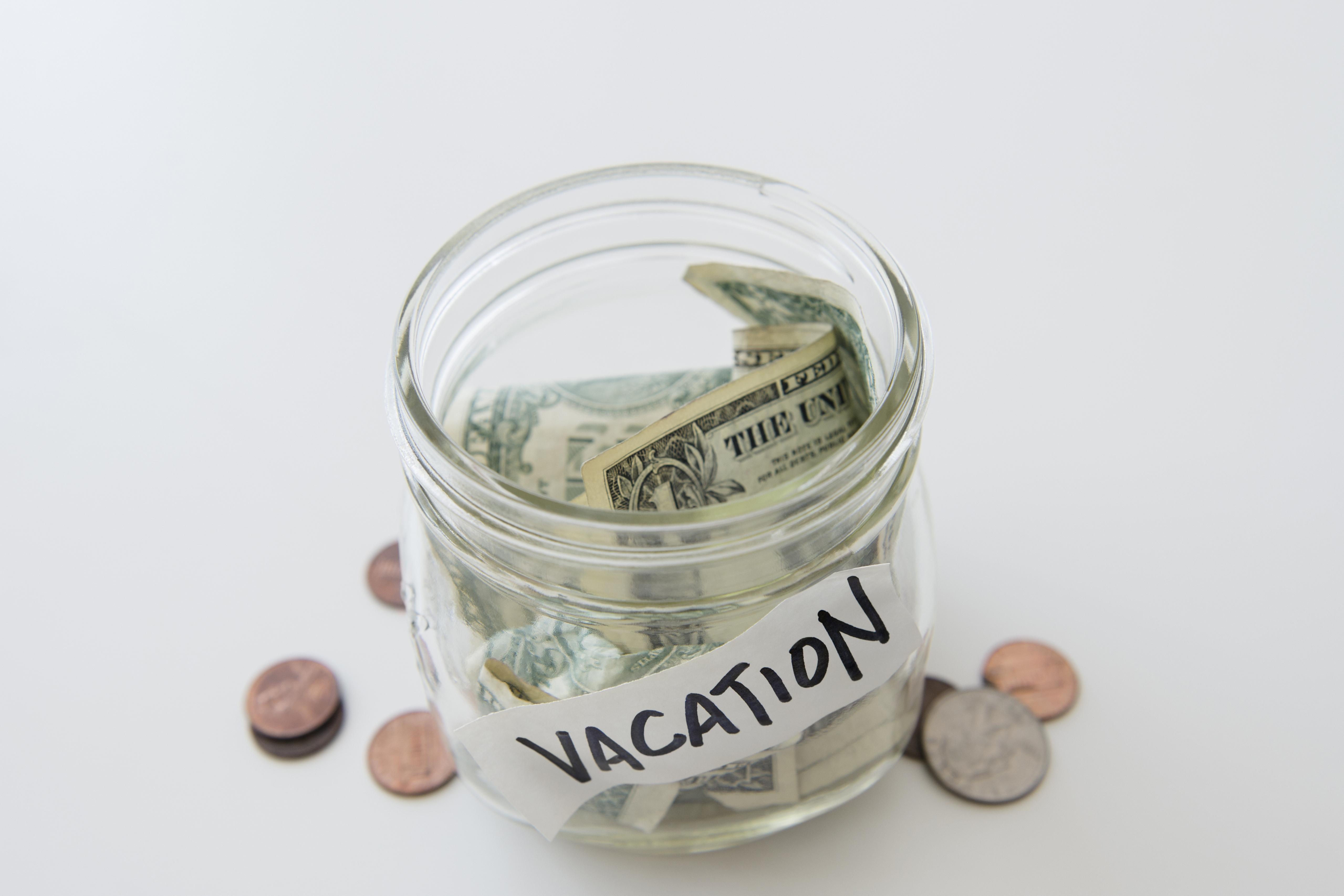 Close up of vacation savings jar