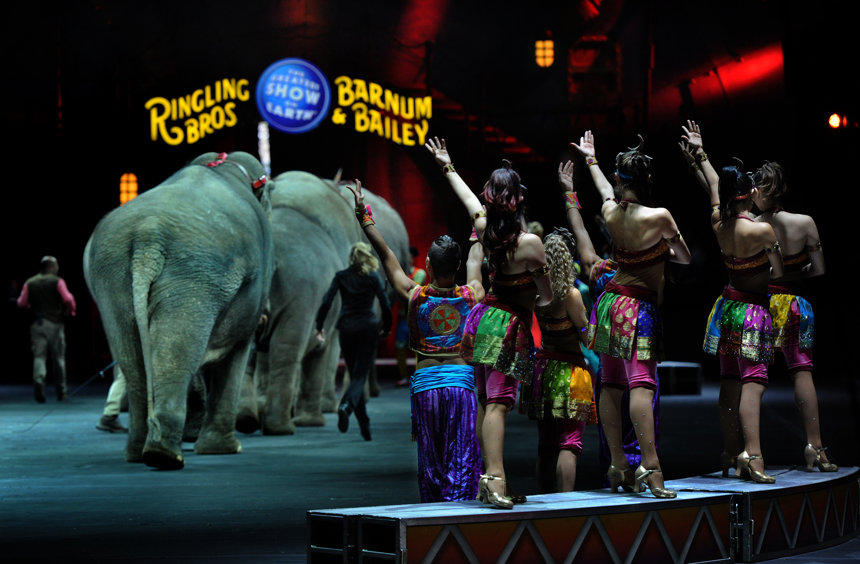 A group of Ringling Bros. performers wave goodbye as the elephants leave the Mohegan Sun Arena in Wilkes-Barre, Pa.