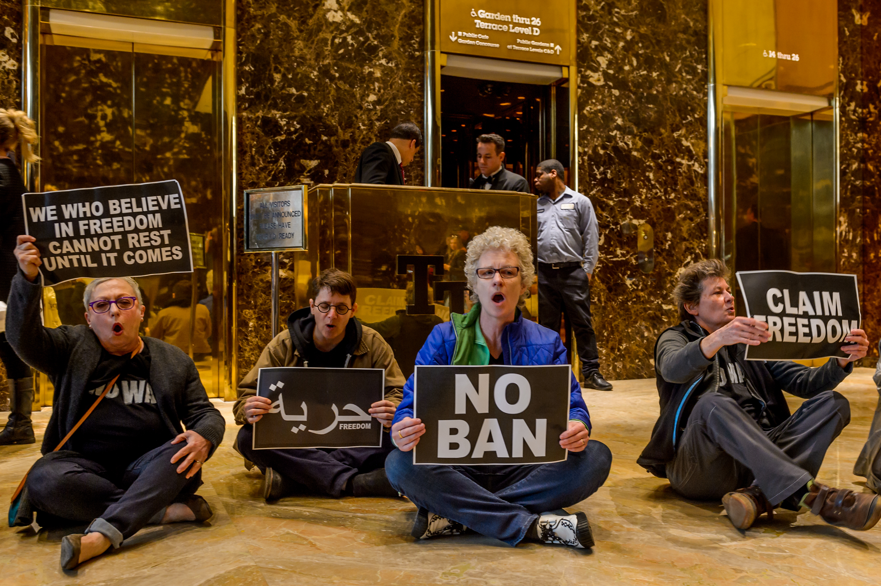 Dozens of activists unfurled anti-Trump banners inside Trump Tower in New York City on April 13, 2017.