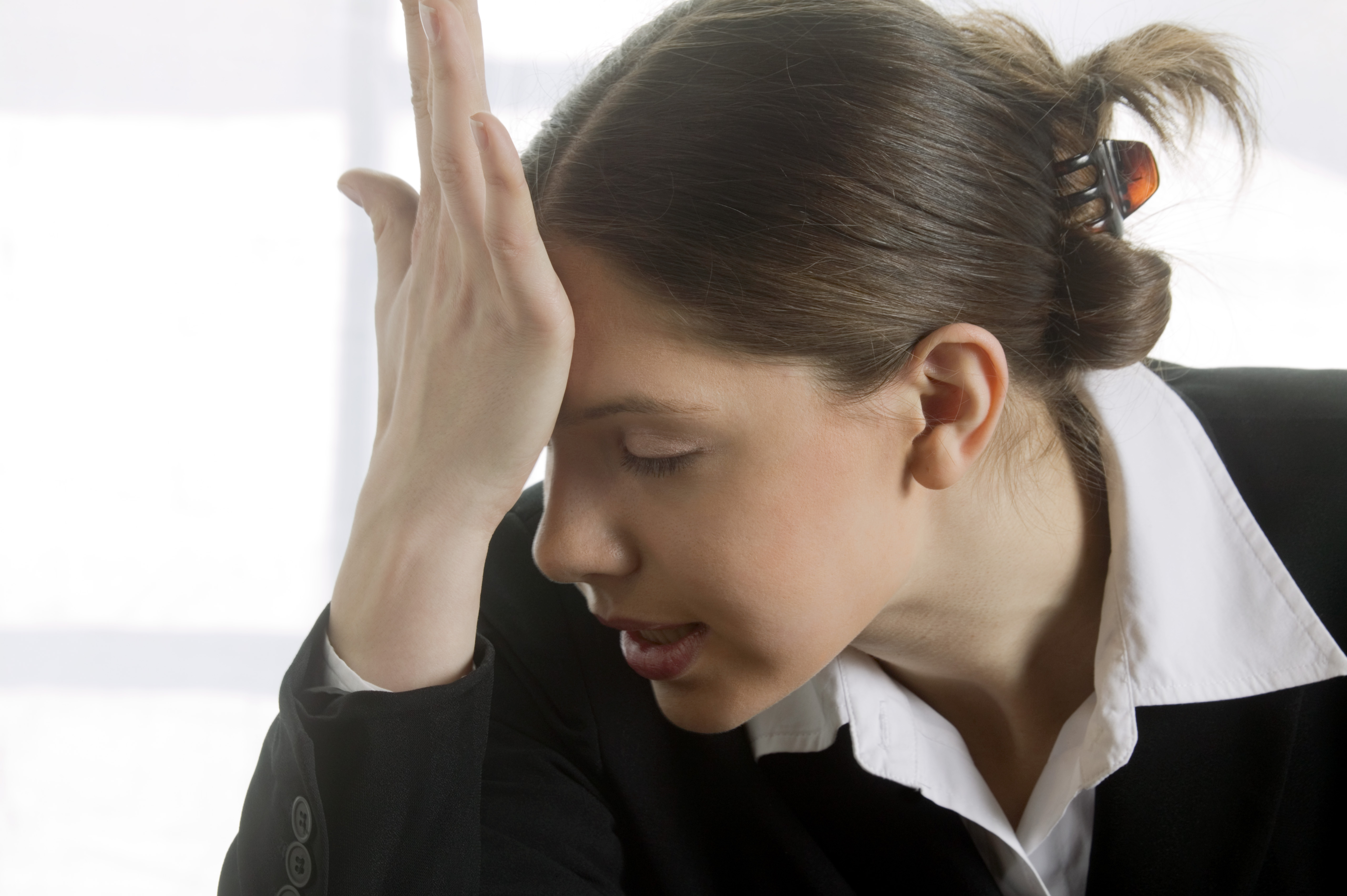 Stressed woman slapping her head
