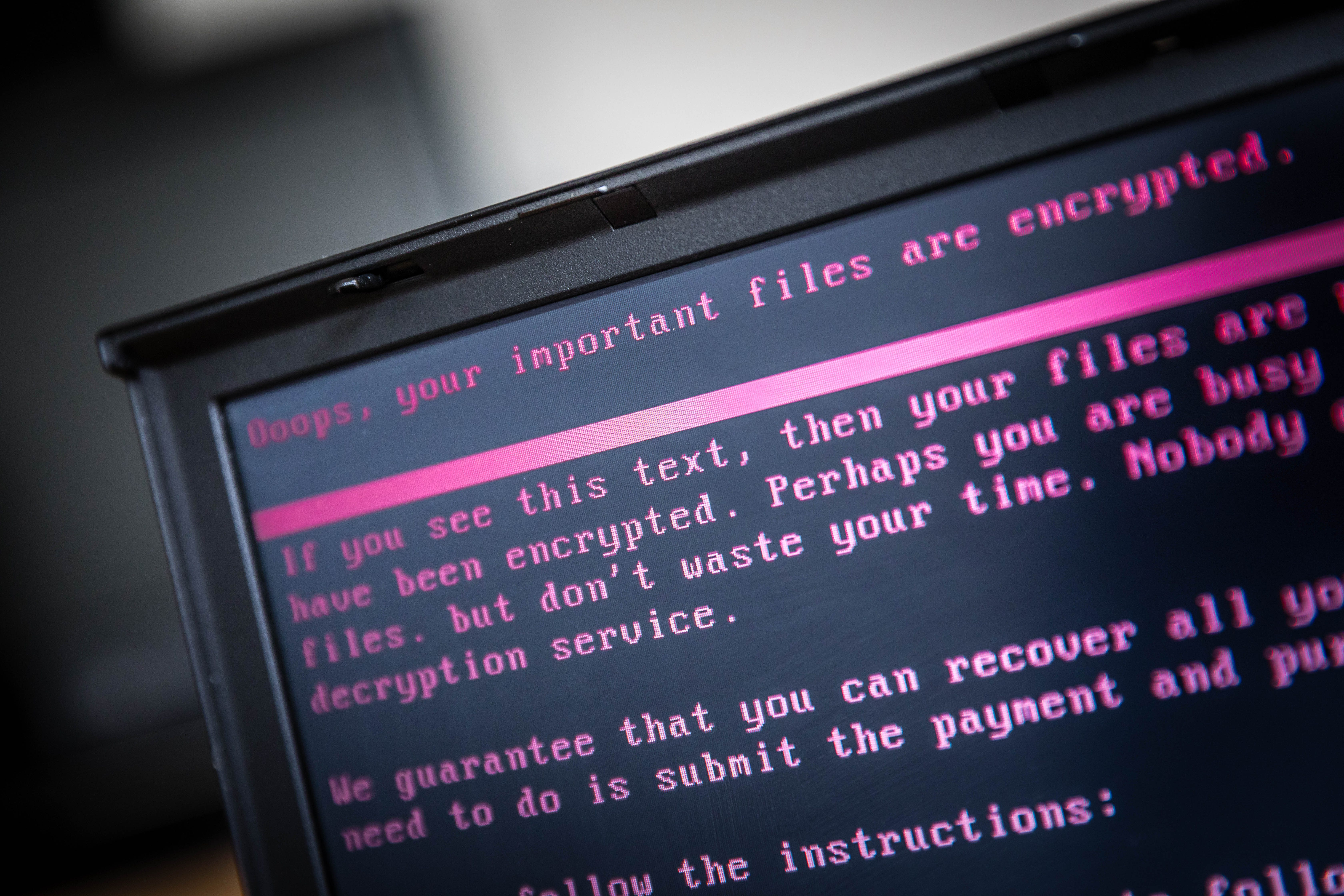 A laptop displays a message after being infected by a ransomware as part of a worldwide cyberattack on June 27, 2017 in Geldrop.