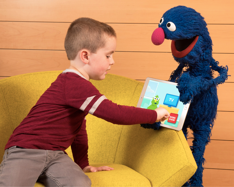 A child shows his friend Grover the new cognitive vocabulary learning app from IBM and Sesame Workshop. The app was recently piloted in Gwinnett County Public School System in Georgia to enhance students' vocabulary development.