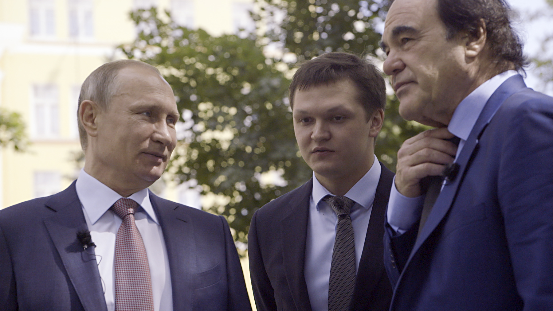 A scene from the Showtime documentary THE PUTIN INTERVIEWS. - Photo:  Komandir/Courtesy of SHOWTIME  Pictured:  Russian President Vladimir Putin, interpreter Sergei Chudinov and Oliver Stone