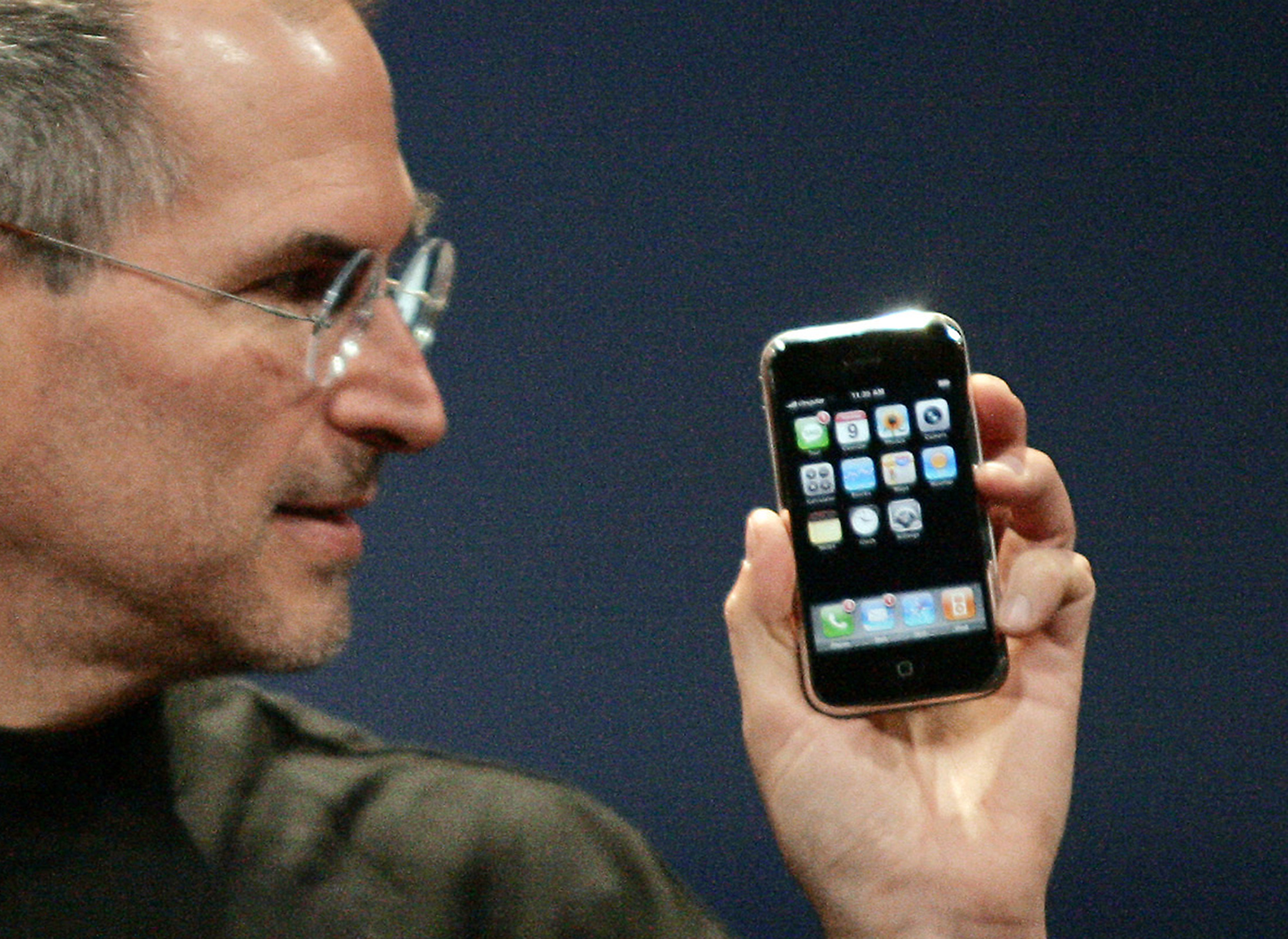 Apple Chief Executive Officer Steve Jobs holds new iPhone in San Francisco