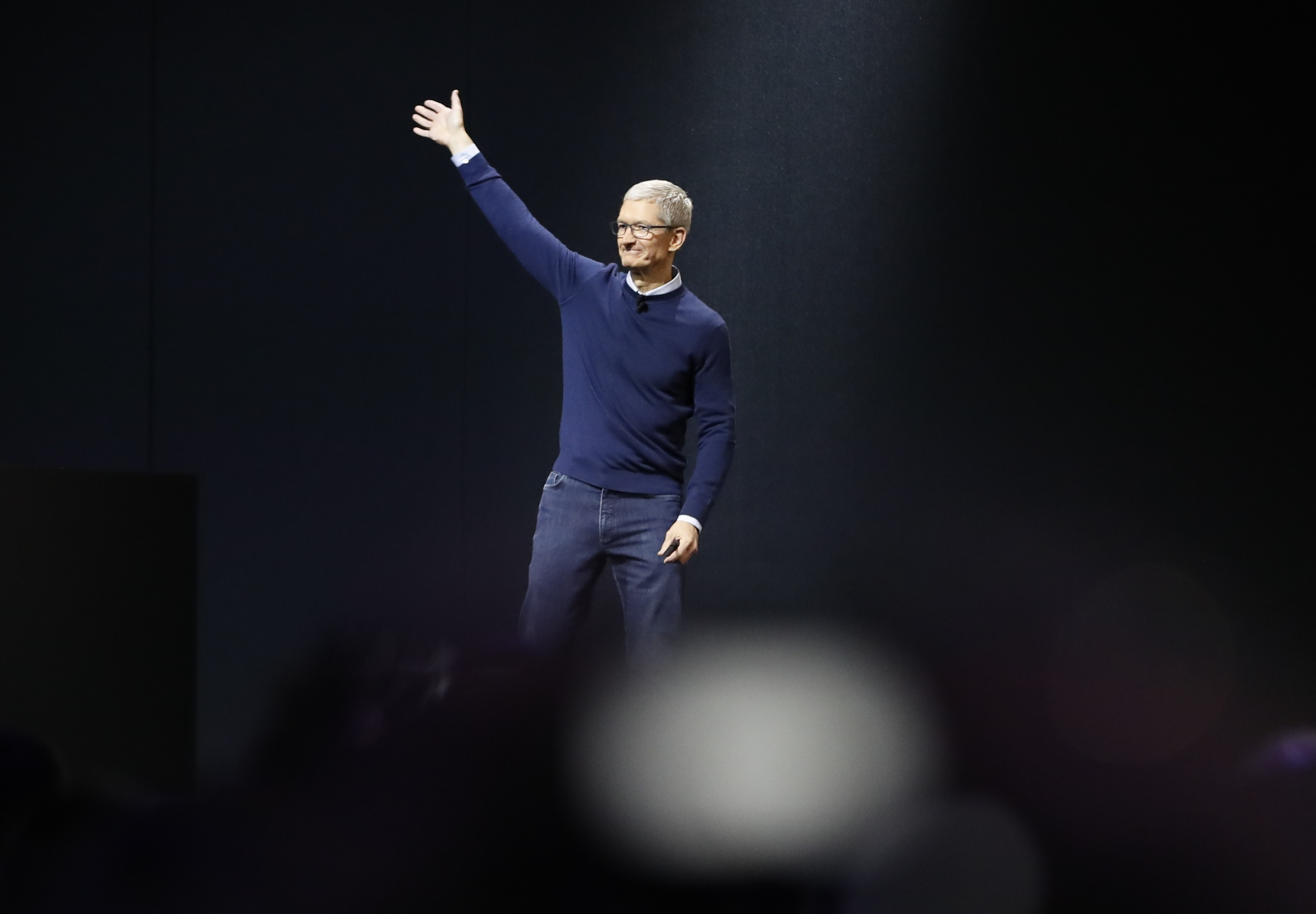 Tim Cook waves during Apple's annual developer conference in San Jose