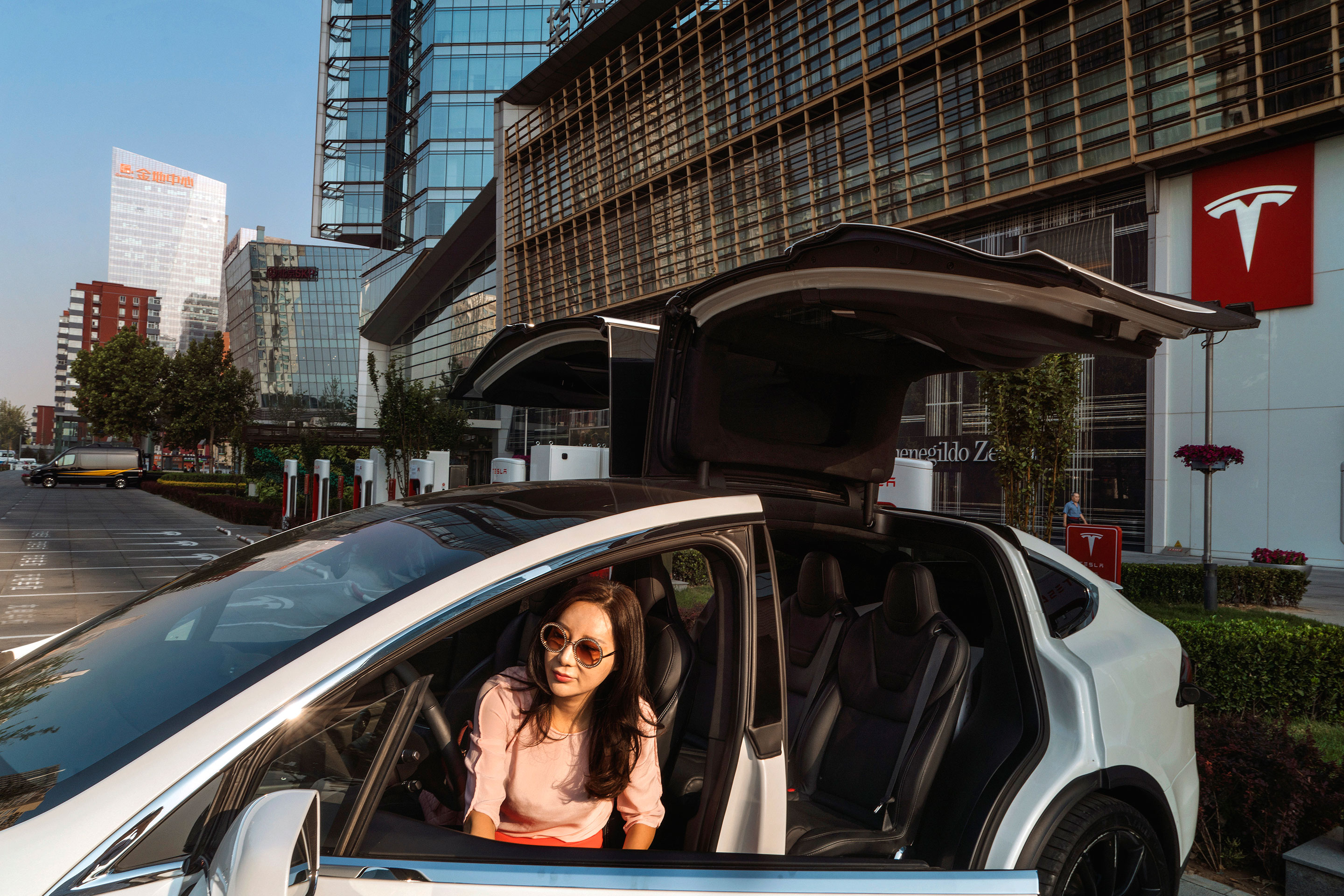 Vanessa Zhu exits her Model X in front of a Tesla showroom in Beijing. Strong demand for SUVs and their perceived safety advantages have fueled Tesla's surge in China.