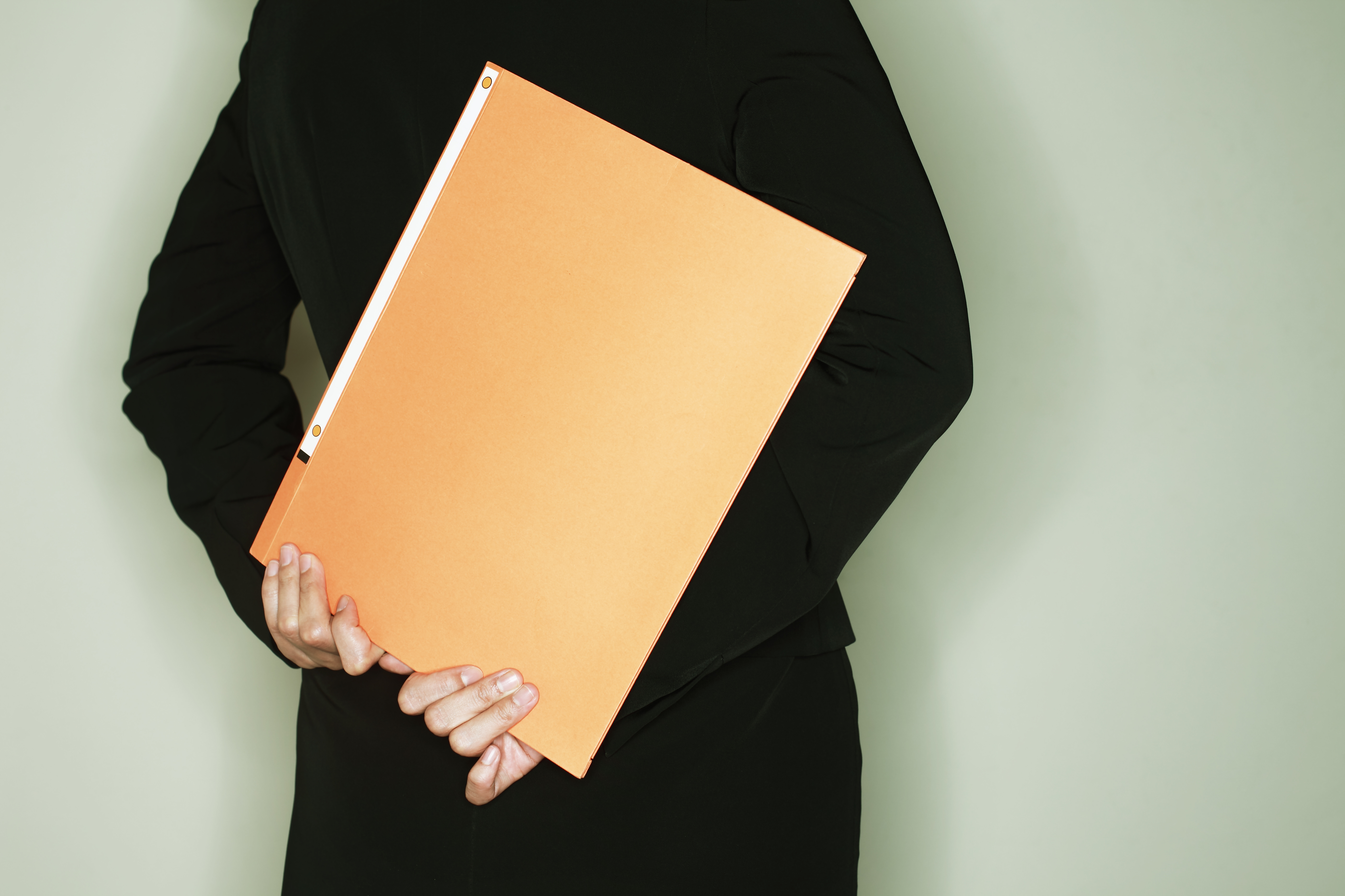 midle age businesswoman with a binder,rear view