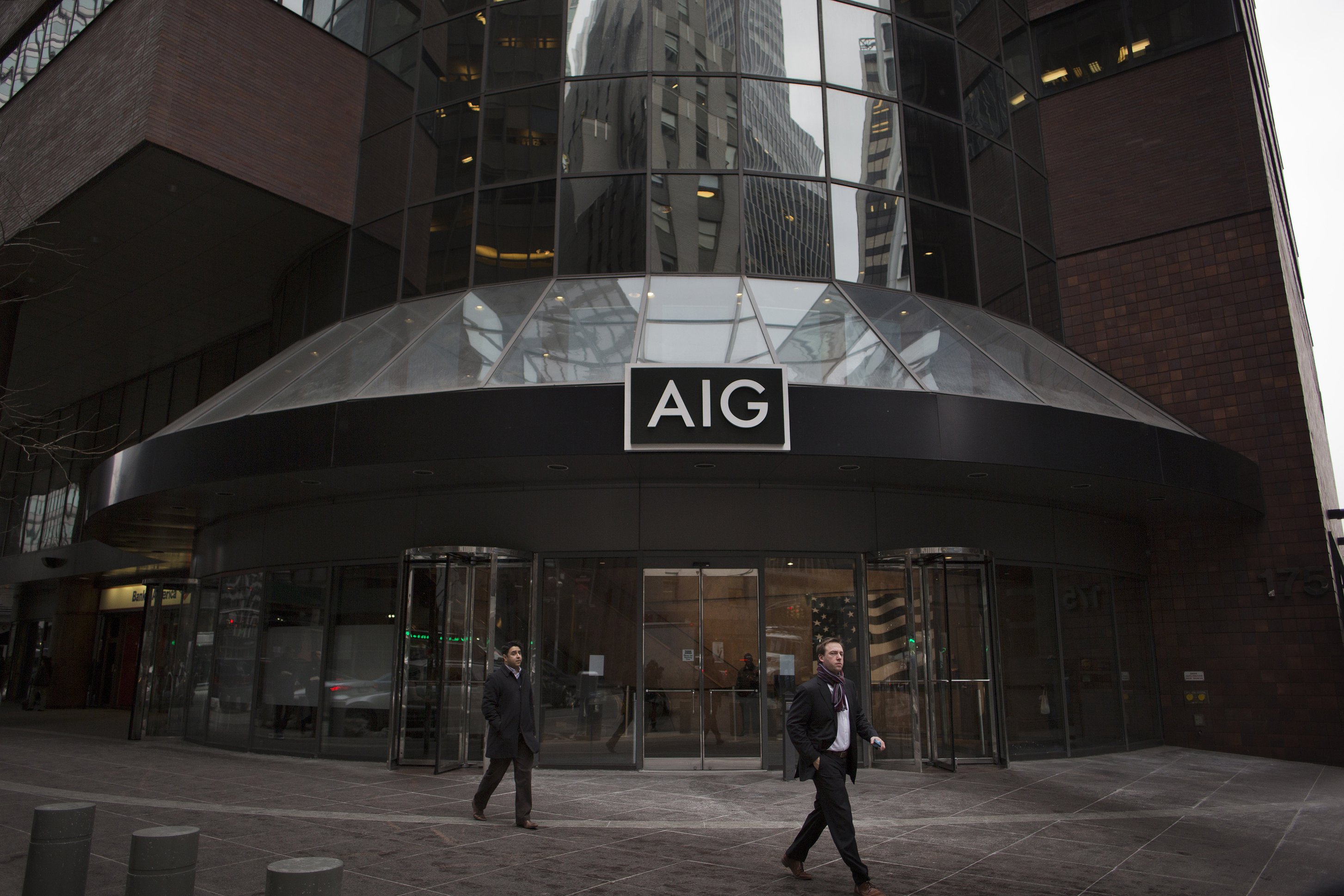 The American International Group Inc. Offices As Company Cut To Negative By S&P On Plan For Stake Sale, Payout