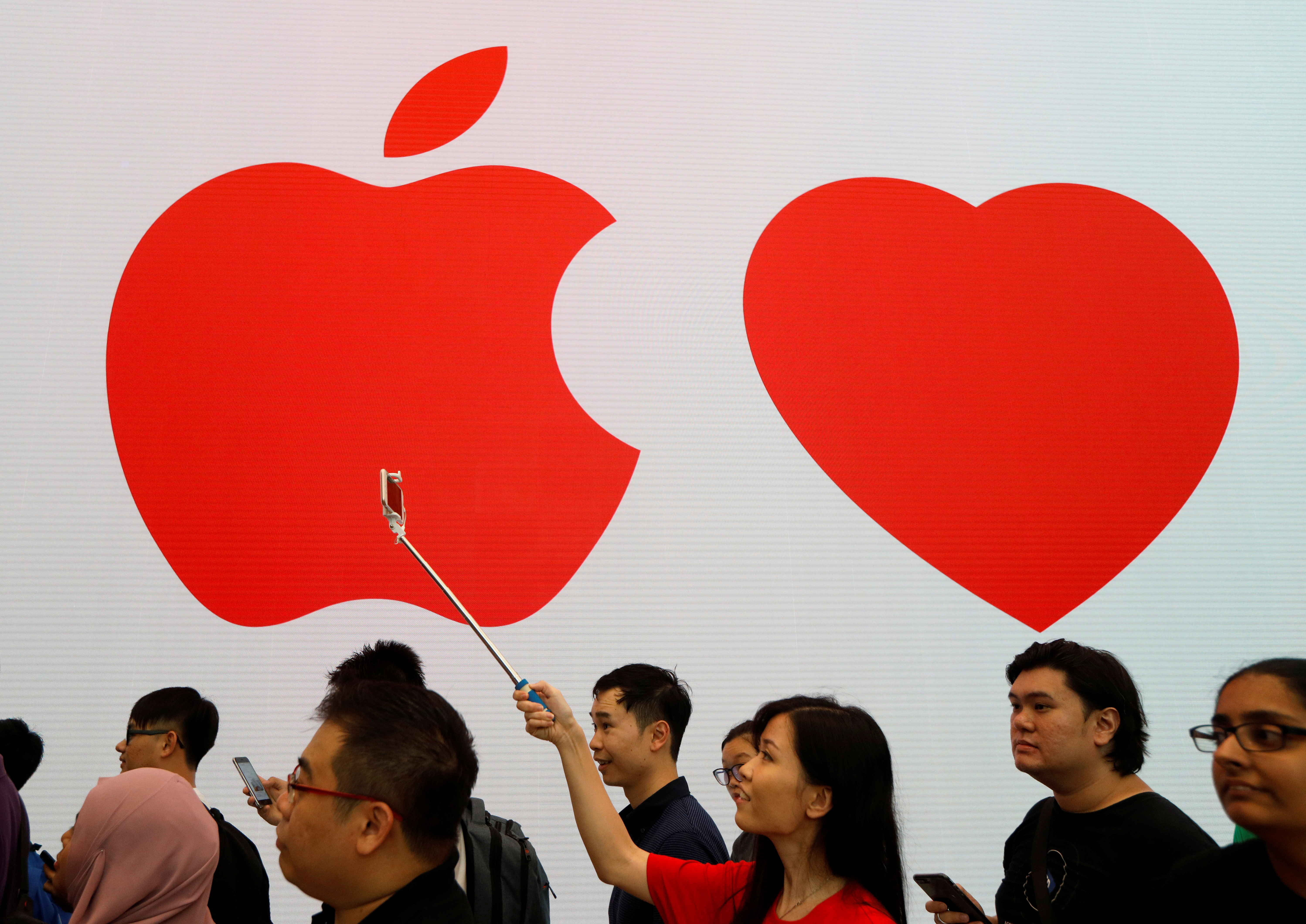 People visit the city-state's first Apple Store on its opening day at Orchard Road, Singapore
