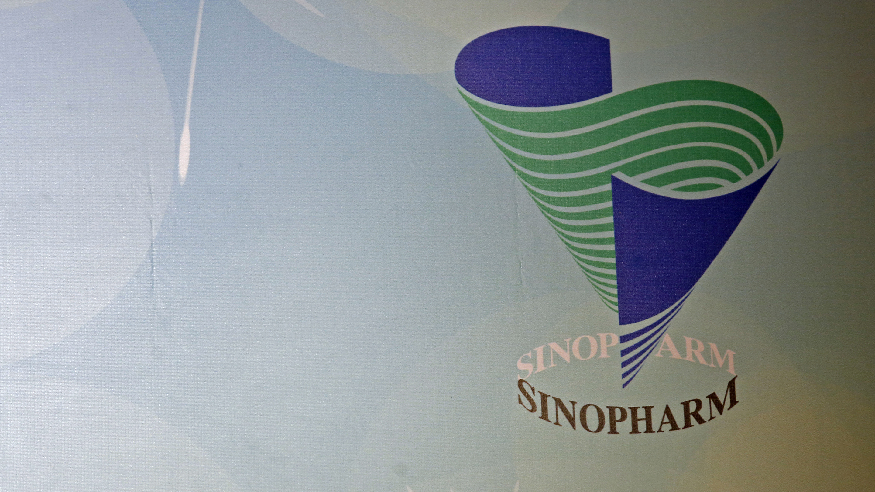 The company logo of Sinopharm Group Co Ltd is displayed at a news conference on the company's annual results in Hong Kong