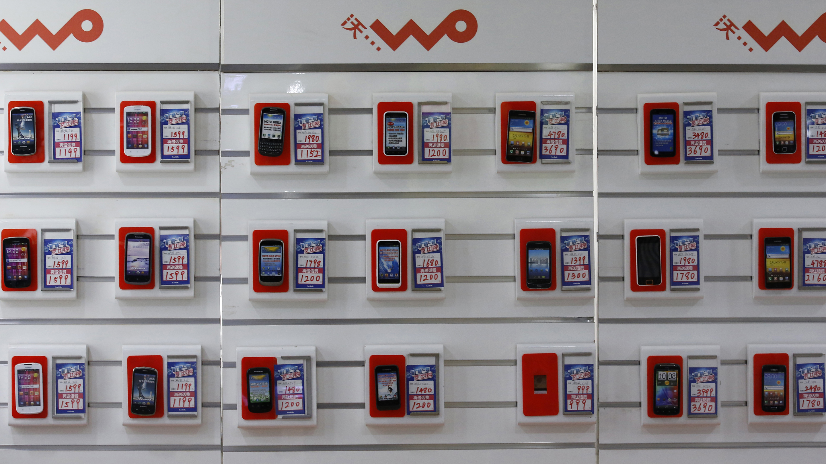 Smartphones are displayed at a China Unicom retail shop in Beijing