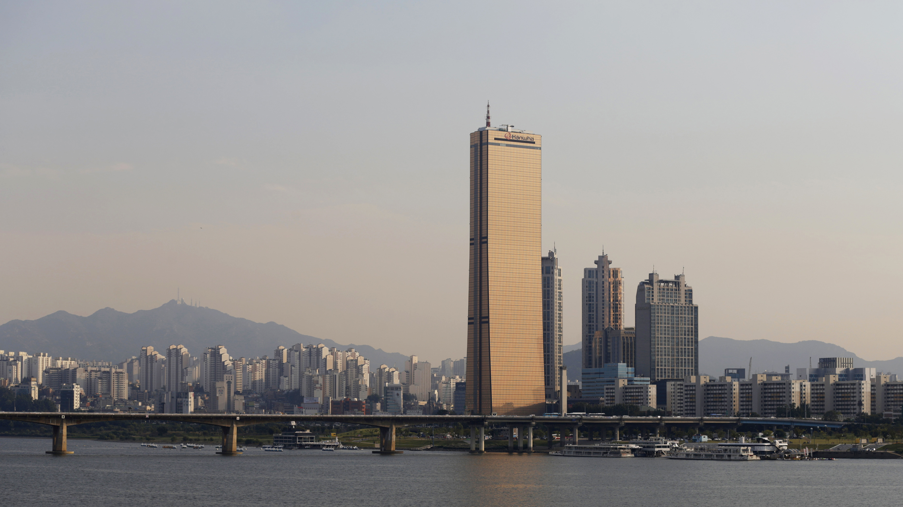 The 63 Building or the Hanhwa 63 City owned by Hanwha Life Insurance is seen on Yeouido island across the Han River at sunset in central Seoul