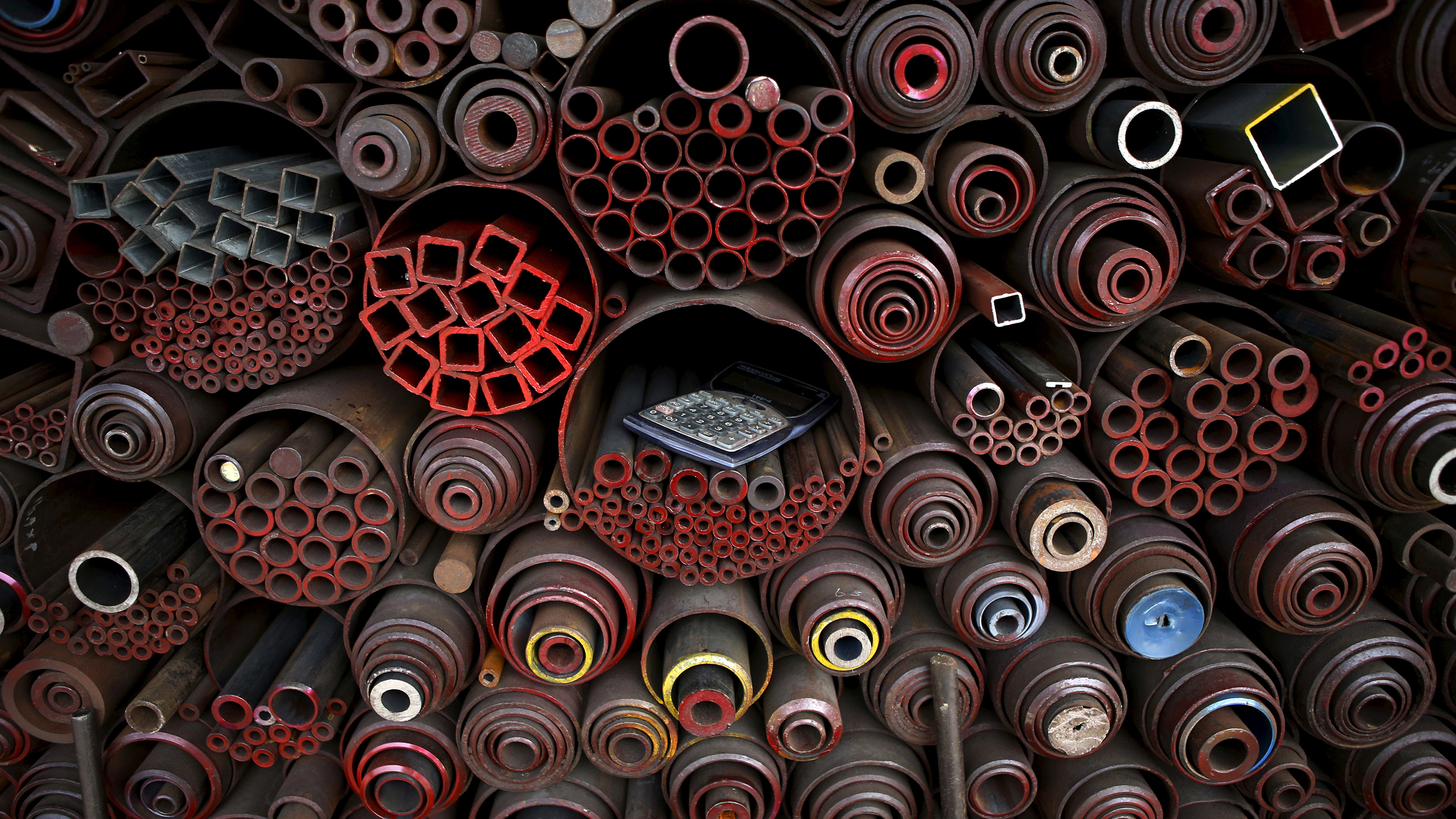 A pocket calculator is seen on steel products stacked at a steelworks in Seoul