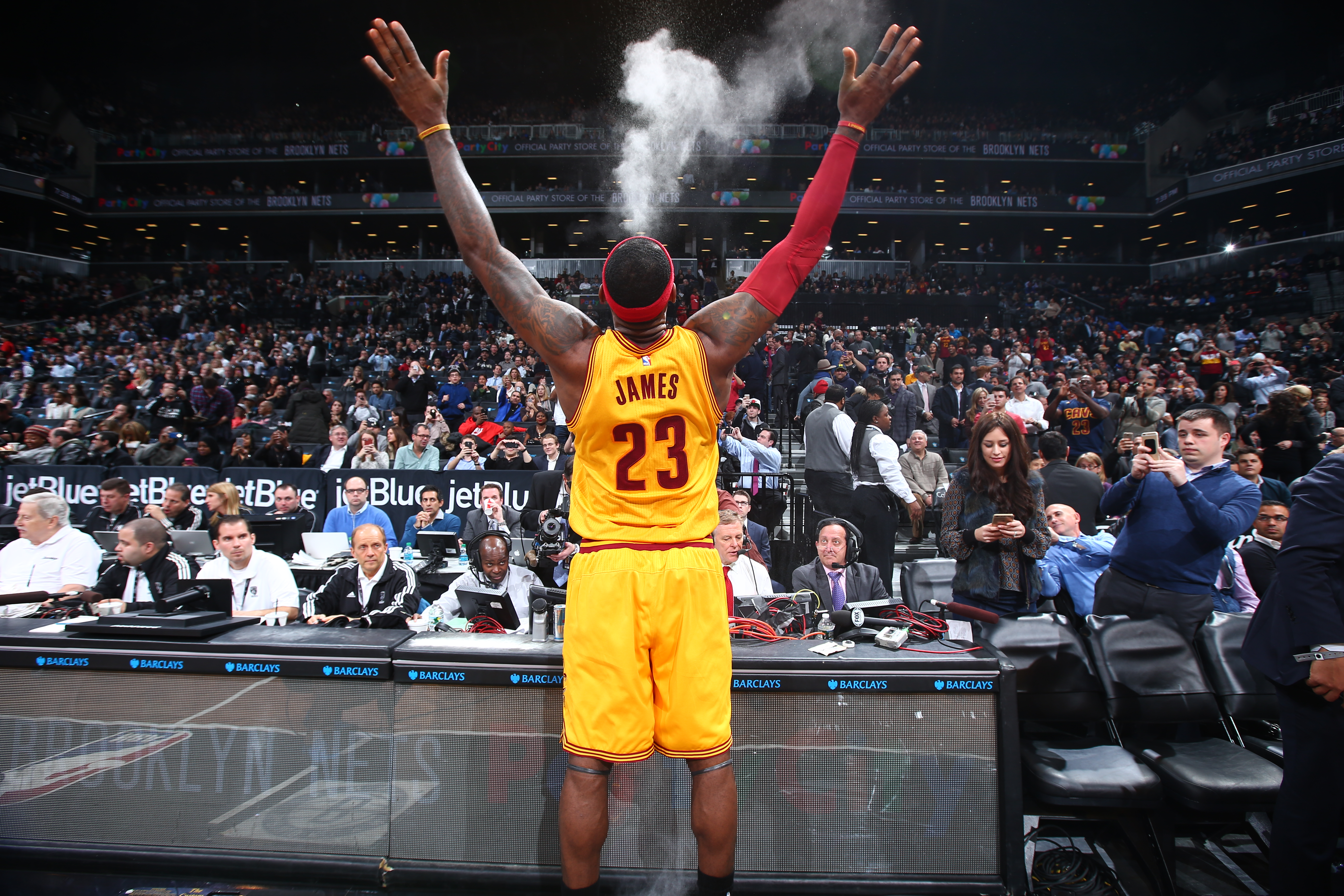 LeBron James of the Cleveland Cavaliers does his chalk toss before the game against the Brooklyn Nets on December 8, 2014 at Barclays Center in Brooklyn, New York.