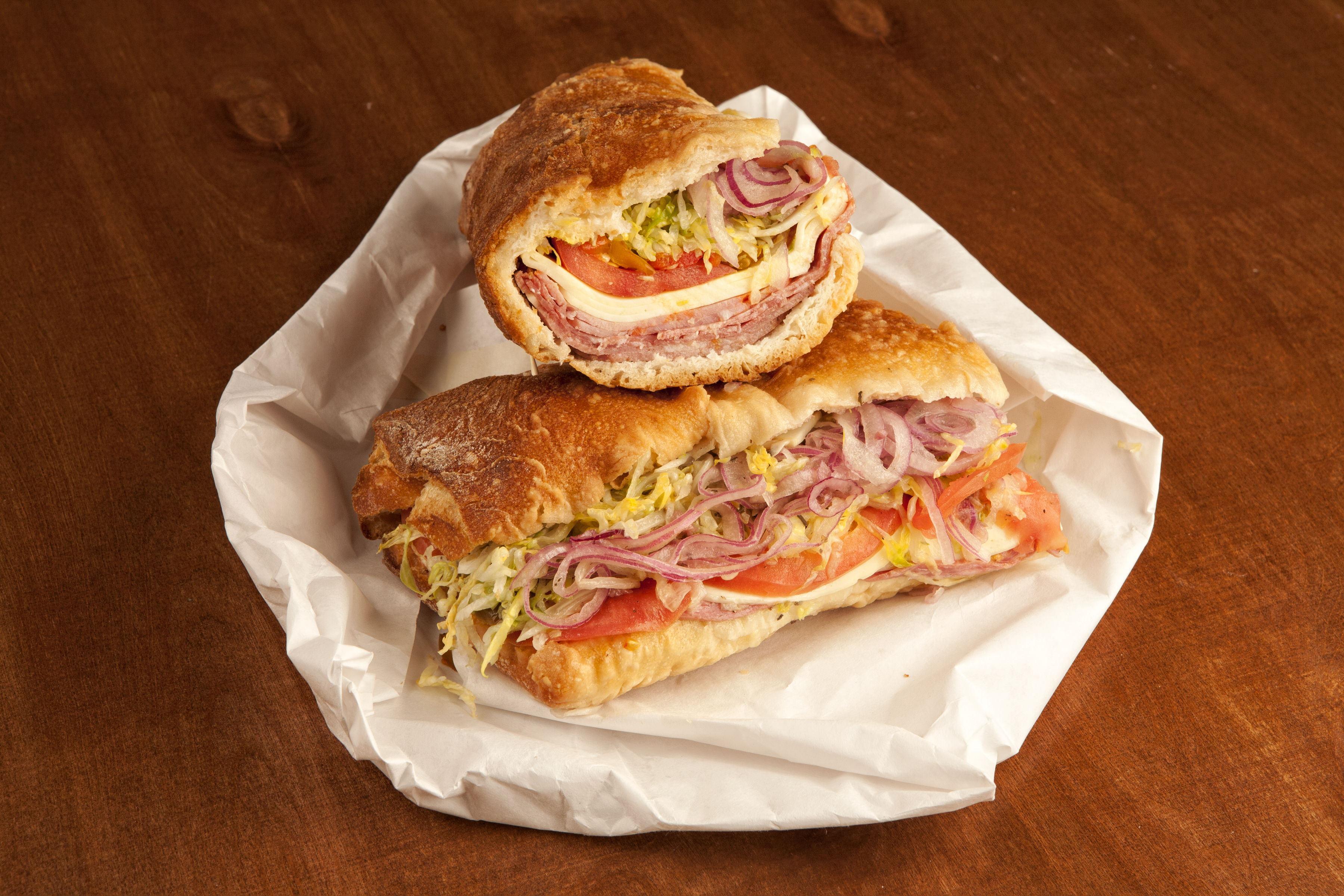 The 4 Meat Grinder, served at Stachowski's Market, 1425 28th St NW in Georgetown, is a behemoth that weighs in more than two pounds, thanks to generously stacked salami, coppa, mortadella and soppressata, all topped with provolone, shredded iceberg lettuce, tomatoes and onions. The meaty sandwich - easily enough to share with a couple of friends - is one of 40 essential eats for 2014.