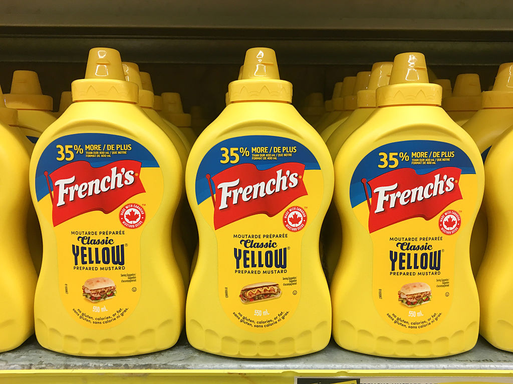 Yellow plastic squeeze bottles of French's mustard sauce