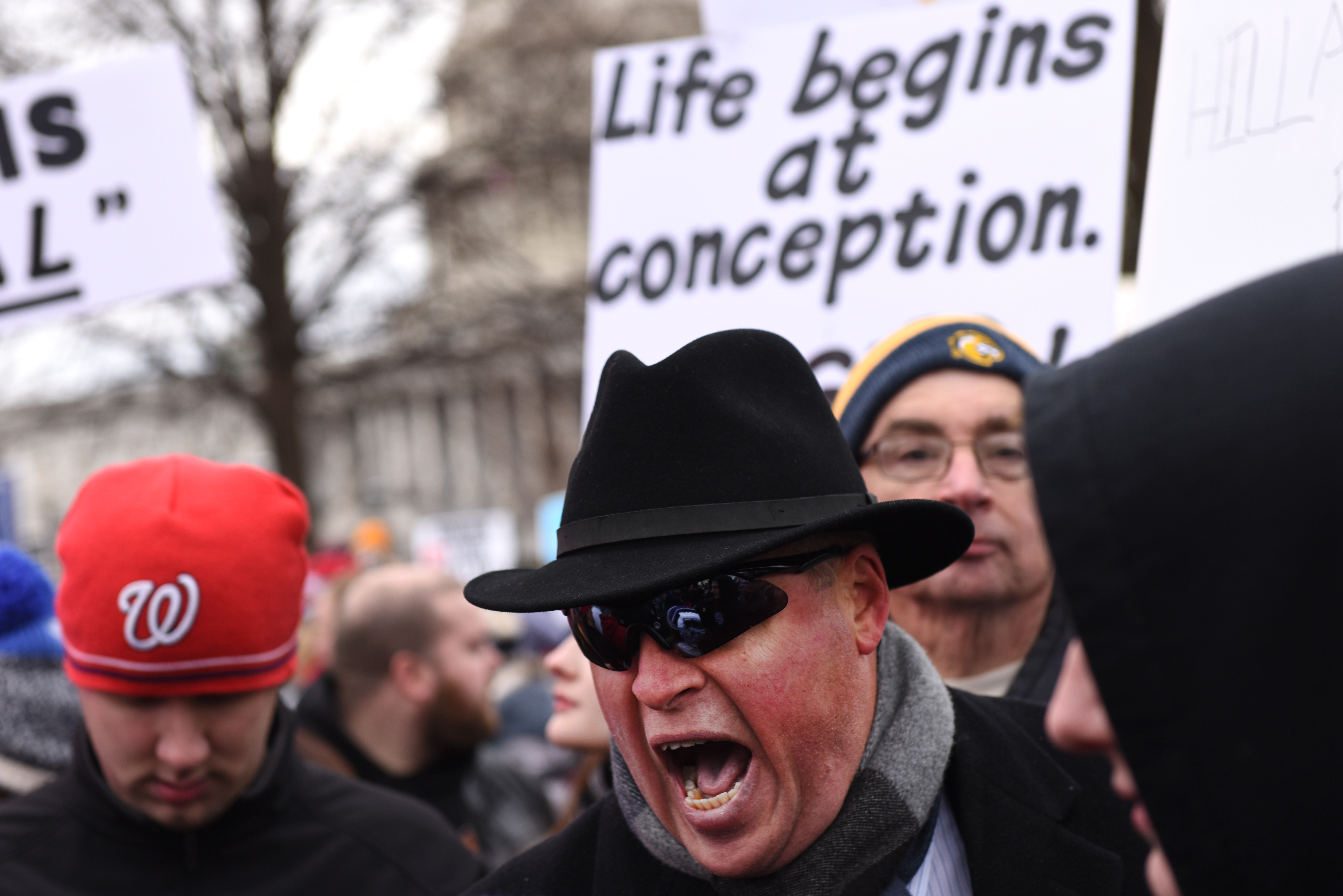 WASHINGTON DC - JANUARY 27: An abortion opponent yells at a pro