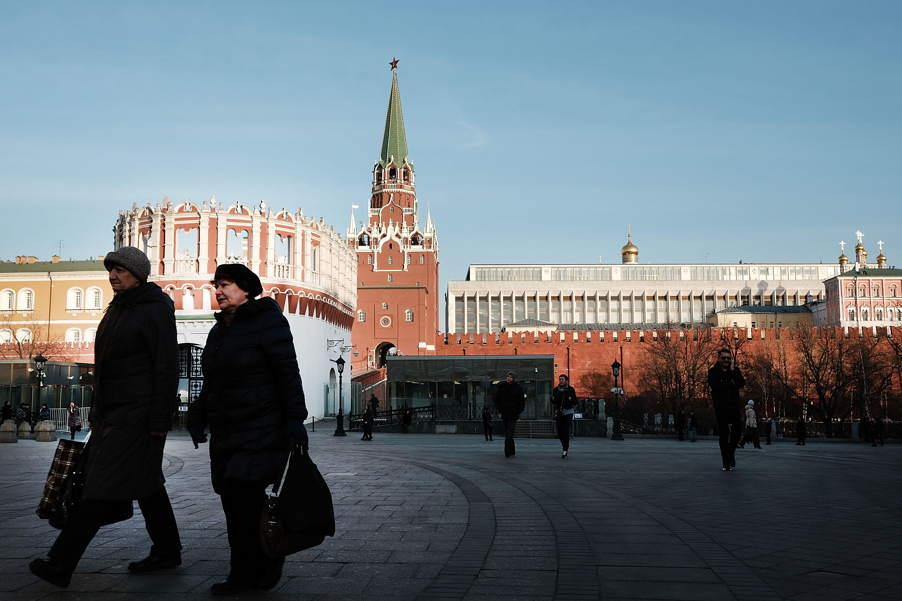 Woman passes by the entrance to the Kremlin on March 10, 2017 in Moscow, Russia.