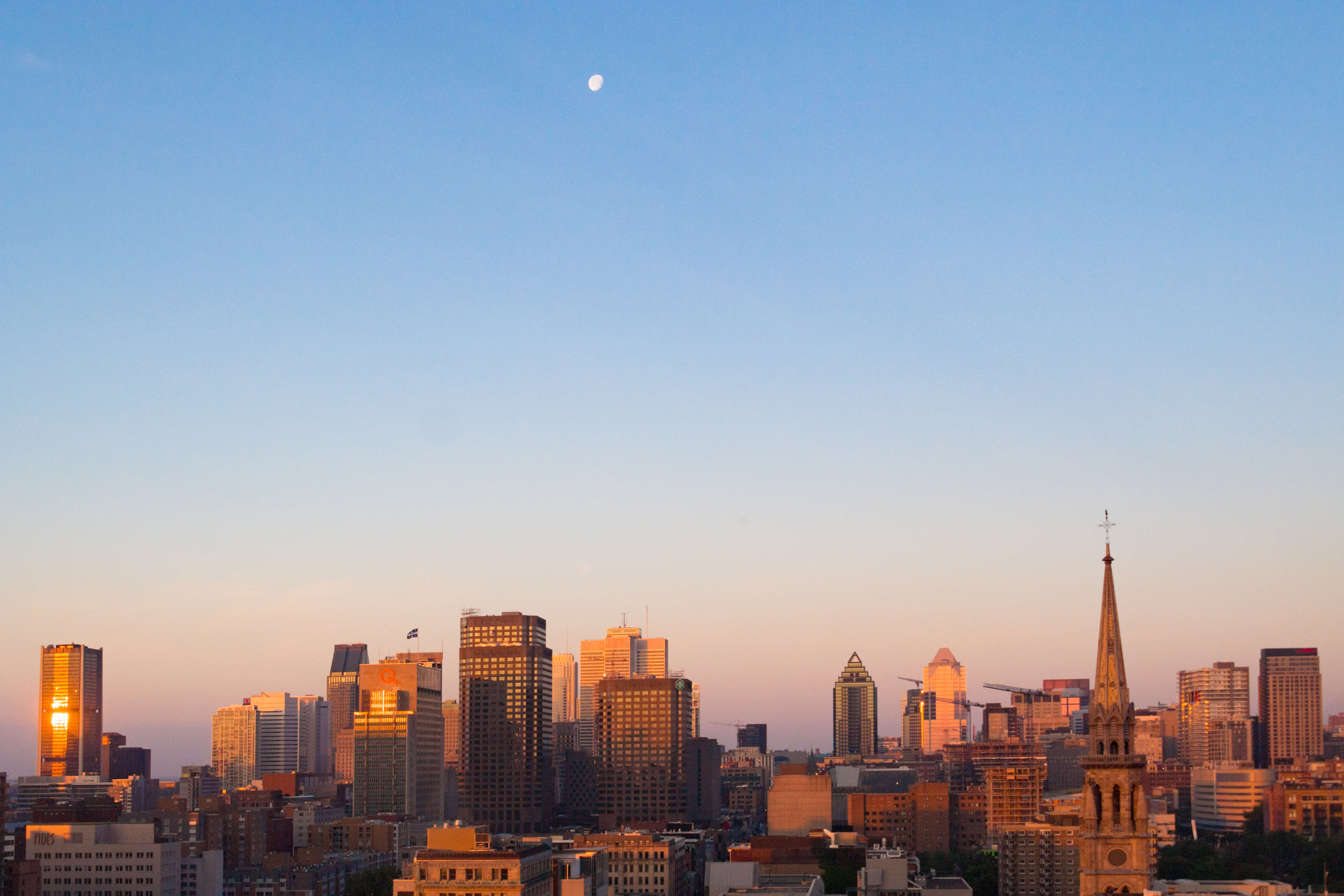 City skyline with moon in the sky. The famous Canadian city